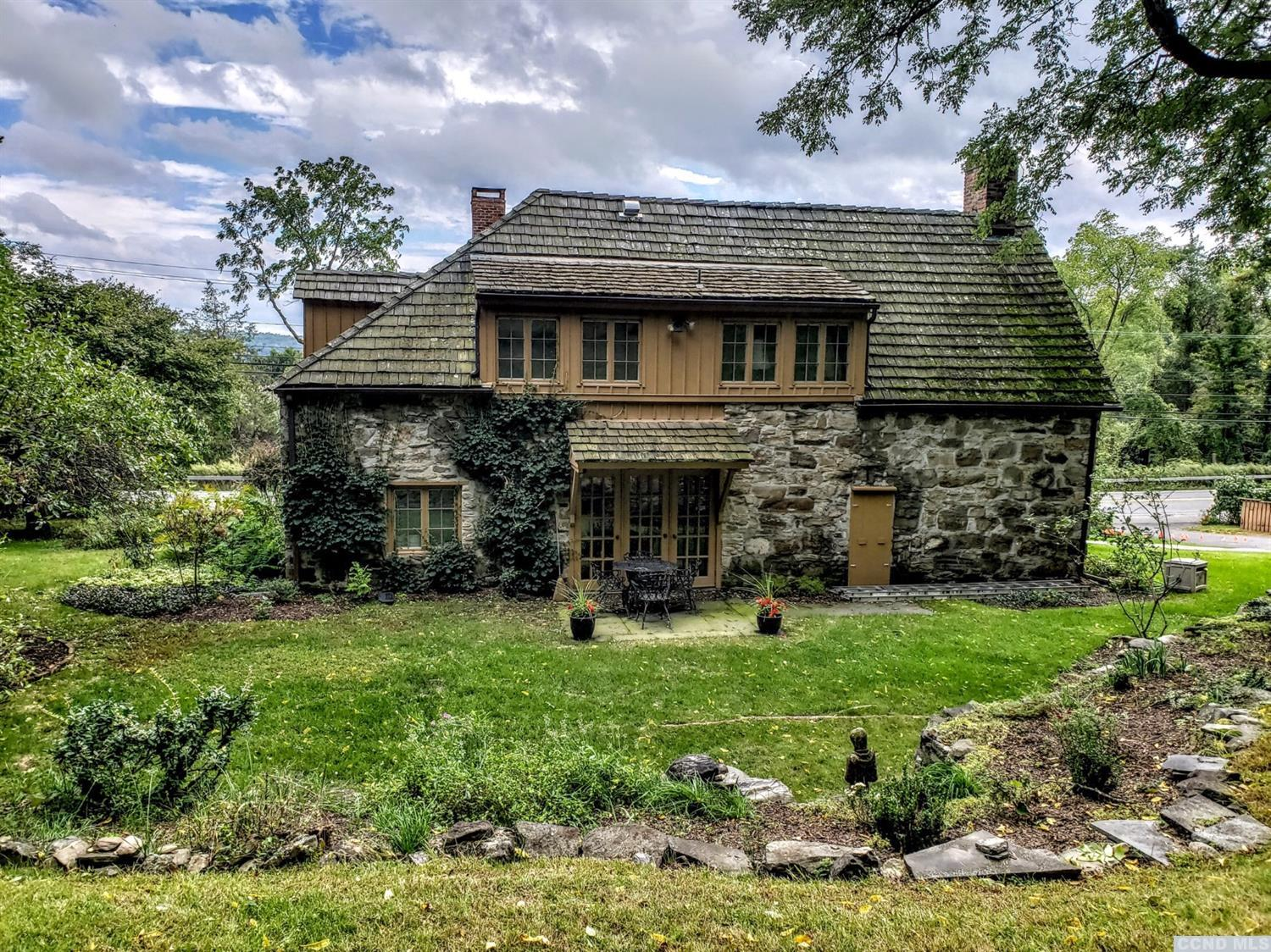 <i><b>This is one of Columbia County's oldest stone houses located just outside the city limit of Hudson on Rte. 9G. If you want to be minutes to great&nbsp;</b></i><i style=font-size: 10pt;><b>restaurants, entertainment, shopping, galleries, Skywalk, Olana, Hudson River cruises, marinas,&nbsp;</b><span 13.3333px;=><b>Amtrak S</b></span><b>tation, hiking, biking, skiing Hunter &amp; Windham Mtns, th</b></i><i style=font-size: 10pt;><b>en this 1700's stonehouse with 4 acres is perfect for you!&nbsp;</b></i><i style=font-size: 10pt;><b>Inside you will love the wide board oak &amp; pine floors, beehive chimney, cathedral ceiling, exposed interior stone walls, chestnut beams, 2 wood burning fireplaces,&nbsp;</b></i><i style=font-size: 10pt;><b>