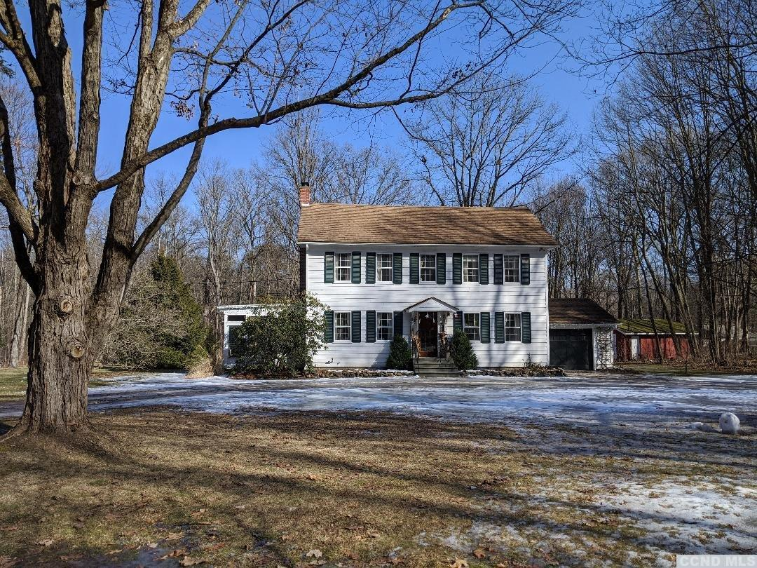 <div>Charming country colonial set back off the road with a circular drive on 3.5 acres. Original hard wood floors,3 bed including a master with walk in closet, with 1 and half baths recently updated, bright and airy move in ready.</div><div>Large open seasonal sunroom, sits off the living room with fire place, formal dining room.</div><div>Light open kitchen with stainless steel appliances opens to a back covered porch, onto a huge level back yard for entertaining or family get togethers. Attached 1 car garage and oversize outbuilding complete this country setting. New 1000 gl.Septic tank, chimney recently re-pointed.</div><div>Close to Chatham center, thruway, parkway, skiing, the Berkshires, all within 20 mins to Albany.</div><div><br></
