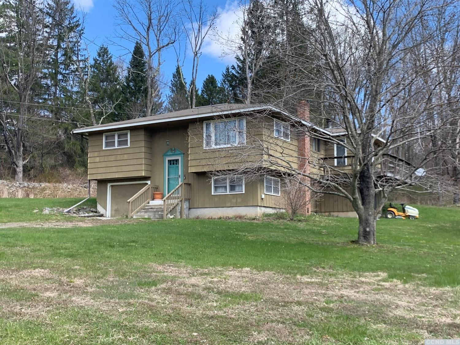 Tidy raised ranch on nearly 7 acres. 2 bedrooms with a possible 3rd. Hardwood floors throughout.  Nice country setting.  Within 30 minutes to Albany, Berkshires, skiing, I-90, Taconic Parkway, Thruway.  Move in ready.