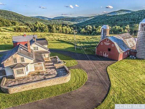 Overlooking breathtaking Catskill mtns/Windham ski resort on your very own private, 158 acre sanctuary of unrestricted views is a centuries old magnificent 5000 sqft farmhouse. Light filled rooms,upgraded recently with only the finest fixtures and quality craftmanship.So many upgrades that you'll smile,including reclaimed cypress,oak & cherry wood floors, bidets in each bath all with the finest porcelain.The kitchen a chefs dream with a commercial size stove,farmhouse sink.The bluestone patios compliment the Mahogany trim and the authentic corbels that grace the outside of the house. Included is a 7 car garage with radiant heat and a finished loft that is spacious enough for a wedding venue or huge family gathering.This is the ultimate