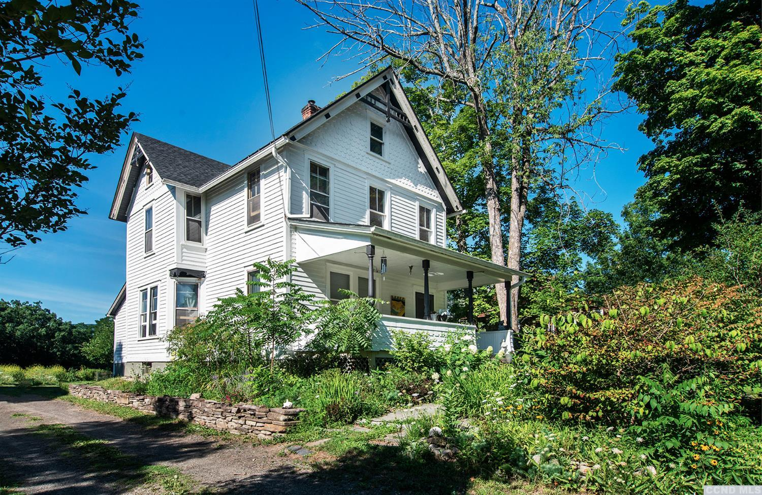 This 3-BR, 2-BA Victorian farmhouse is loaded with casual Bohemian chic & charm, including exposed brick walls, a lofted third floor, wide-plank oak flooring, open kitchen shelving, & a claw-foot soaking tub. Many of the home's original architectural details are intact, & there's a large front porch on which to spend balmy summer afternoons & evenings. The expansive backyard borders a picturesque open meadow, where, from time to time, bovine species can be spotted grazing the day away. (Whatever could be more bucolic!) And, several windows of the upper two floors peek directly at the Catskills in the distance. Modern appliances, abundant closet space, a Pacific Energy wood stove, updated electrical service & eclectic light fixtures througho