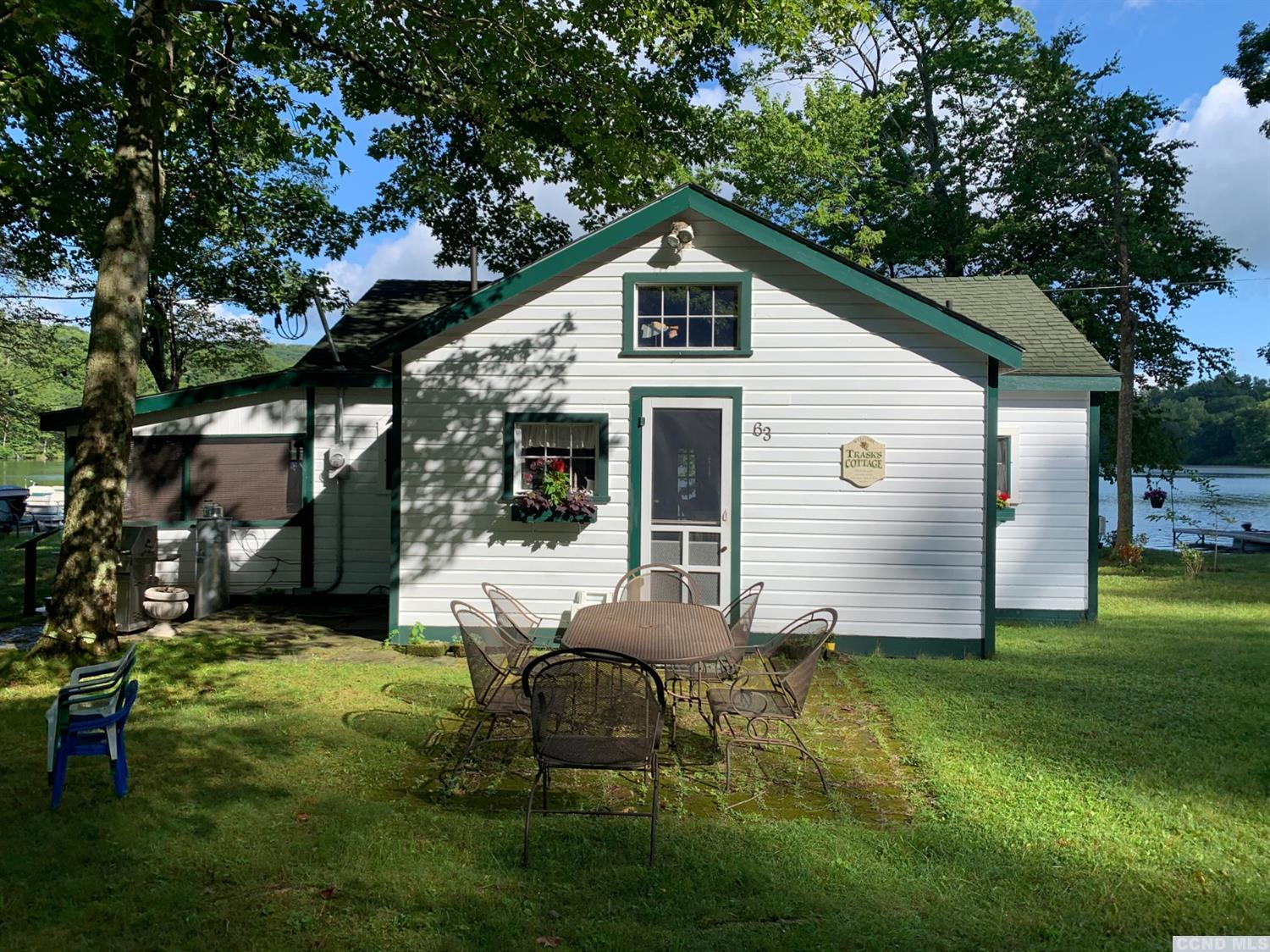 Lake front cottage on most sought after Queechy Lake, one of the cleanest lakes in New York.<br>Wrap around screened in porch. Open layout, granite kitchen counters, with views through the house of the lake. Paddle fans, rustic wood interior, hardwood floors. new central air/heating system with back up wood stove for chilly summer nights.<br>Open great room with two lofts with queens size beds overlook the lake and your two private boat docks. View is to the West which offers morning and afternoon sunshine and gorgeous sunsets.  Plenty of parking unlike most lakefront homes. Private association beach.<br>Move in and enjoy summer fun.<br>