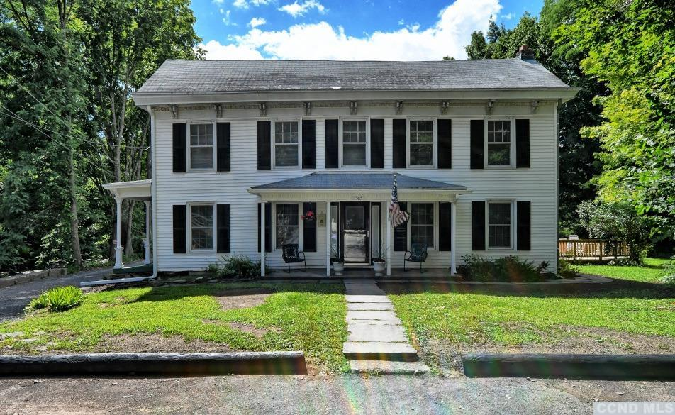 A Beautiful Center Hall Colonial with 5 Bedrooms and 3 Bathrooms Creek-side! The home has over 3,300 sq ft, a formal dining room, a living room, an eat-in kitchen, a laundry room, multiple rooms on the first floor for a bedroom or a home office, and multiple bedrooms and rooms on the 2nd floor. The home has front and side covered porches, a rear deck for entertaining, beautiful Brazilian Tiger Hardwood floors, & a nice back yard for play. The Main St residence offers walking distance and access to the local stores, park, and amenities on Main St. It's a Great Home along the Shingle Kill Creek! View our 3D Virtual Tour for this home.