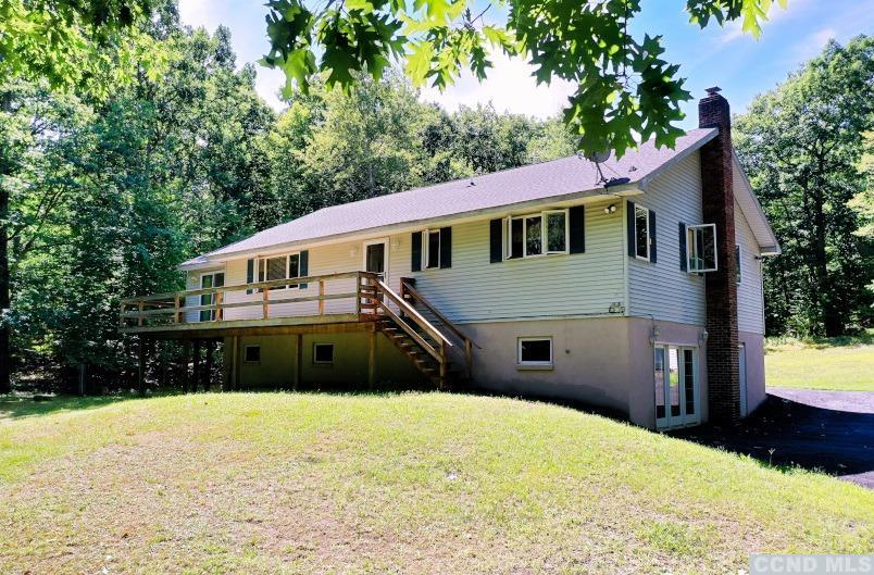 A Spacious 4 Bedroom, 2 Bath Raised Ranch Home with a 2 Car Garage on 2.66 Acres! The home features 4 bedrooms with a master bedroom & bath suite, a large living room, a kitchen with a breakfast bar, a large sunroom, a full finished basement with a huge family room & a 4th bedroom, a 2 car garage, front & rear decks, & a paved driveway. The home has a beautiful setting with privacy in the quaint hamlet of Round Top. It has great proximity to Blackhead Mountain Lodge & Country Club for golf & leisure, to Winter Clove Inn & Resort for dining, the Log Cabin Cafe for breakfast or lunch, Cairo's business district for shopping, and the town park. The home is only 25 to 30 minutes to Windham & Hunter Ski Mountains. A Great Home in a Beautiful Setting! View our 3D Virtual Tour of the home.