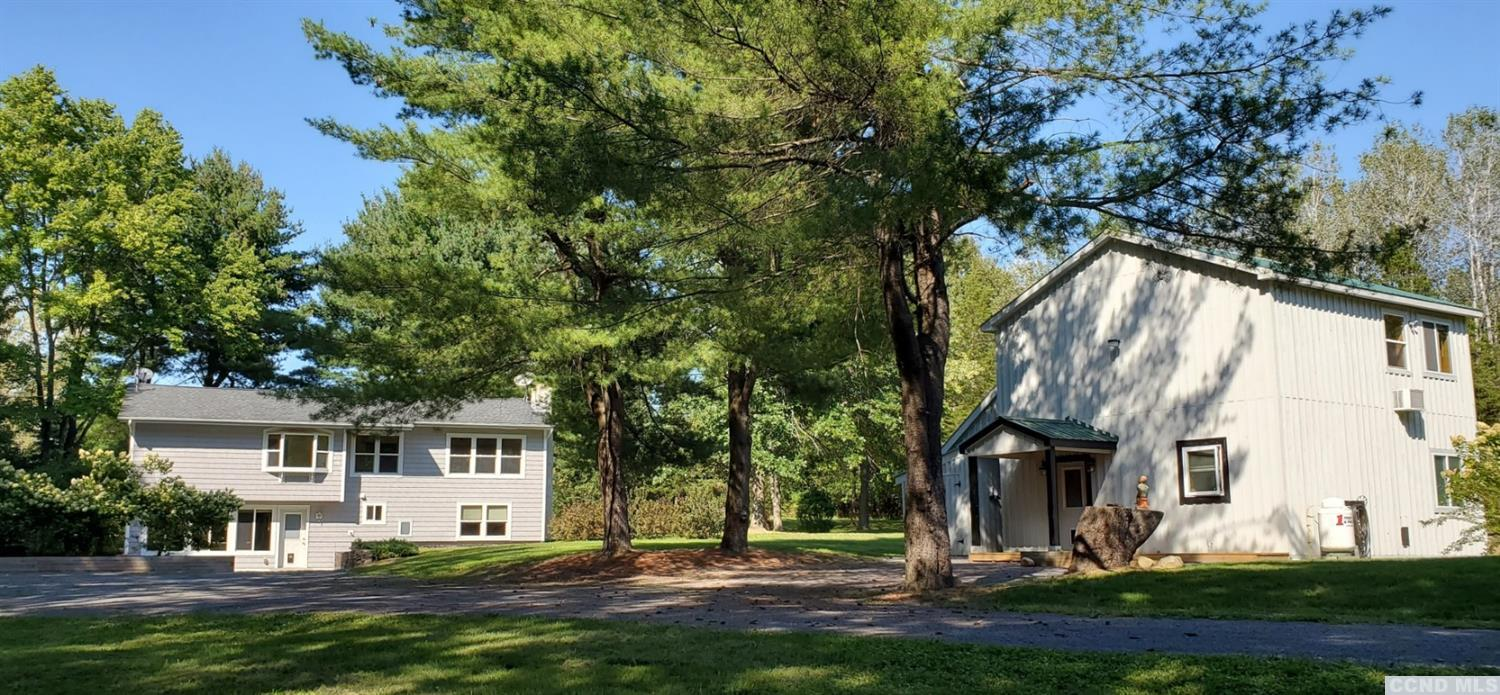 <div><span style=10pt;=>Just minutes from Germantown is a rare opportunity to own two houses on 3 ac.of lush trees and meadows. A 2200 sq. ft. two family residence with 4BR and 4BA. and a&nbsp; 2BR &amp; 2BA&nbsp; w/</span><span style=font-size: 10pt;=><span 10pt;=>1800 sq ft.guest house.</span><span 10pt;=style=font-size:>Each floor of the two family residence has been designed with exceptional taste and finishes. The upper level boasts beautiful hardwood floors, newer kitchen and appliances, two bedrooms, w/ private baths, laundry room, fireplace,a/c, and a spacious deck . The lower level is designed with a more rustic, yet cozy, feel using stained knotty pine. A open concept kitchen &amp; dining area, two bedrooms w/ private baths,firepl