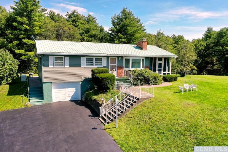 A Beautiful Setting & Home on 5.4 Acres with Mountain Views! The home features 3 bedrooms, 2 baths, a spacious sunroom, a living room with a stone fireplace, a kitchen, a dining area, a finished basement, and a 1 car garage. The home has 2 back patios, a large back deck, plenty of yard space, a paved driveway, and a shed. The property has plenty of yard space for play, gardening, planting, sledding, & additions. View our 3D Virtual Tour of the home and the drone aerial pictures.