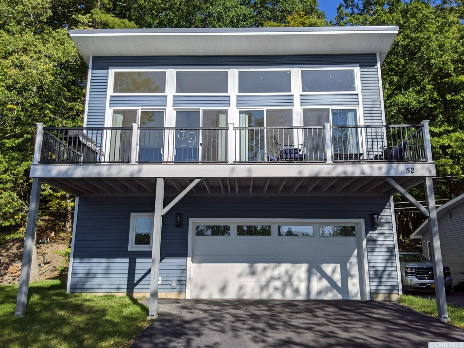 Contemporary home, newly built in 2020. Words can not describe the feeling of this truly unique lakefront home. The 4 giant sliding glass doors with over-sized transoms lead onto the 2nd level deck overlooking the lake, blending indoor/outdoor living. The 14 foot vaulted ceiling adds to the feeling of open space. Home features knotty pine flooring, shiplap ceiling, floor to ceiling stacked stone gas fireplace, modern cabinetry, backsplash, composite deck, custom lighting/ceiling fans, full bath on second floor, custom vanity, 1/2 bath on first w/exterior access, over-sized garage, tankless hot water, central air, propane heat. Dock has built-in benches and slab for firepit. The house is on a one lane, dead end street with a 15 MPH speed lim