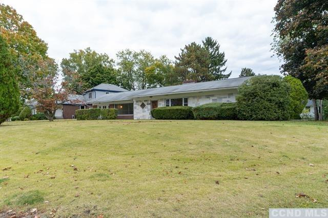 Single-level 1952 expanded ranch-style home. Fuse the old with the new to suit your lifestyle. Refre