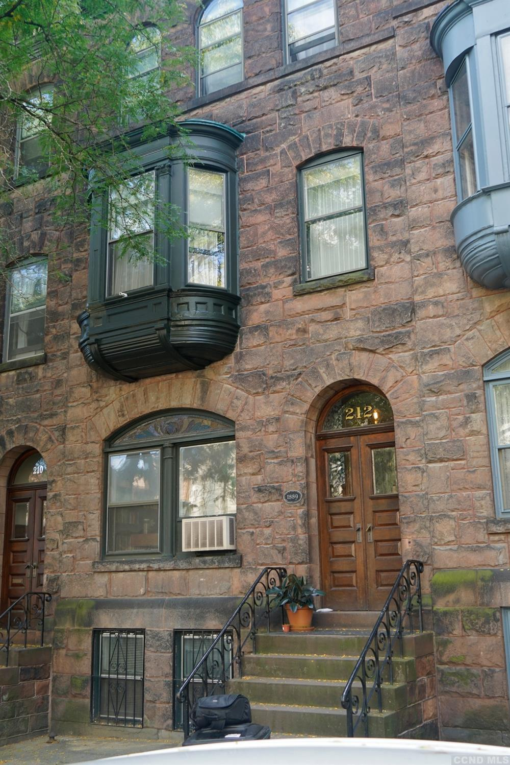 This Richardson Romanesque style brownstone was built by James W Eaton in1889. In the late 1880's Ea