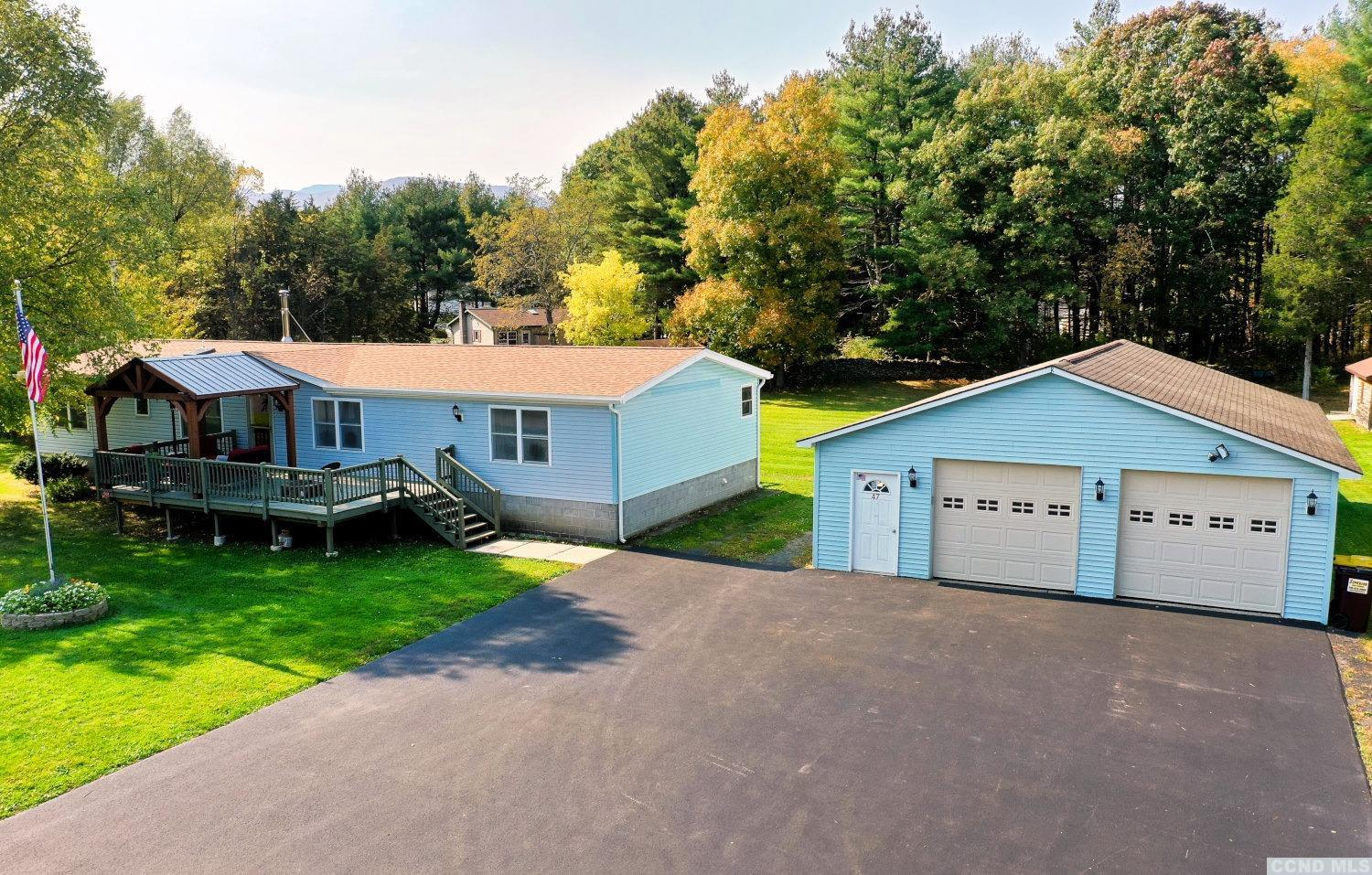 A Large 3 Bedroom, 2 Bath Ranch Home with an Oversized 2+ Car Garage with a 2nd Parcel of Land! The home features a master bedroom & bath suite, a large living room with a wood stove, a kitchen, a formal dining room, a den or office, a back screened porch, a front deck, a 2 to 4 car garage, a carport, a She shed for an office or writing cabin with heat, a paved driveway, and spacious yards. There are 2 parcels of land with this sale for a total of 1.83 acres. The adjacent corner lot has been excavated and tested. The 2nd lot can remain vacant or be built on. The home has been impeccably maintained. It's a Beautiful Home in a Beautiful Setting! View our 3D Virtual Tour of the home.