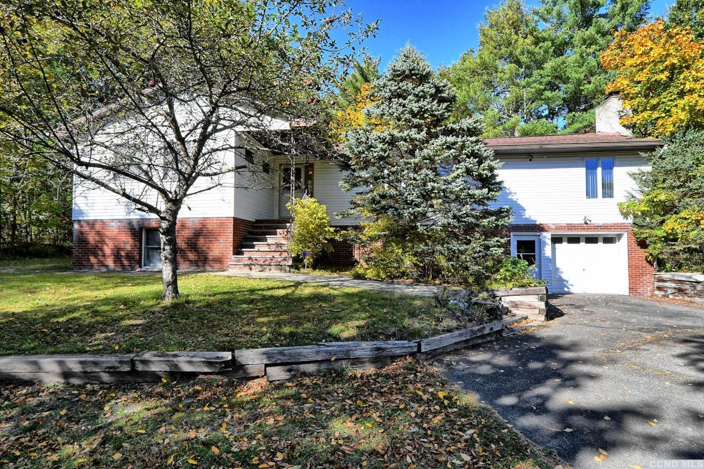 A Fantastic Home & Property with 3 Bedrooms, 2 Baths, a Former 8 Bedroom Boarding House, and a Pond on 8.43 Acres! The home features 3 bedrooms & 2 baths - including a master bedroom & bath suite, an open dining area & living room with a brick fireplace, an eat-in kitchen, a full basement that could be finished for additional living space, an office, or a mother/daughter apartment - which has a separate entrance, a 1 car garage, & a paved driveway. The charming boarding house features 8 bedrooms, 2 bathrooms, and vintage furniture & appointments from that era. It could be used as a guest house, an artist's studio, a barn, an office, or a business or retail center. The home, the former boarding house, & the pond are nestled into the 8.43 acres among the Chestnut trees with privacy. Just 15 minutes to Windham Ski Mountain & 25 minutes to Hunter Ski Mountain. It's minutes to Golf Resorts & Zoom Flume Water Park. It's a Beautiful Home & Property!
