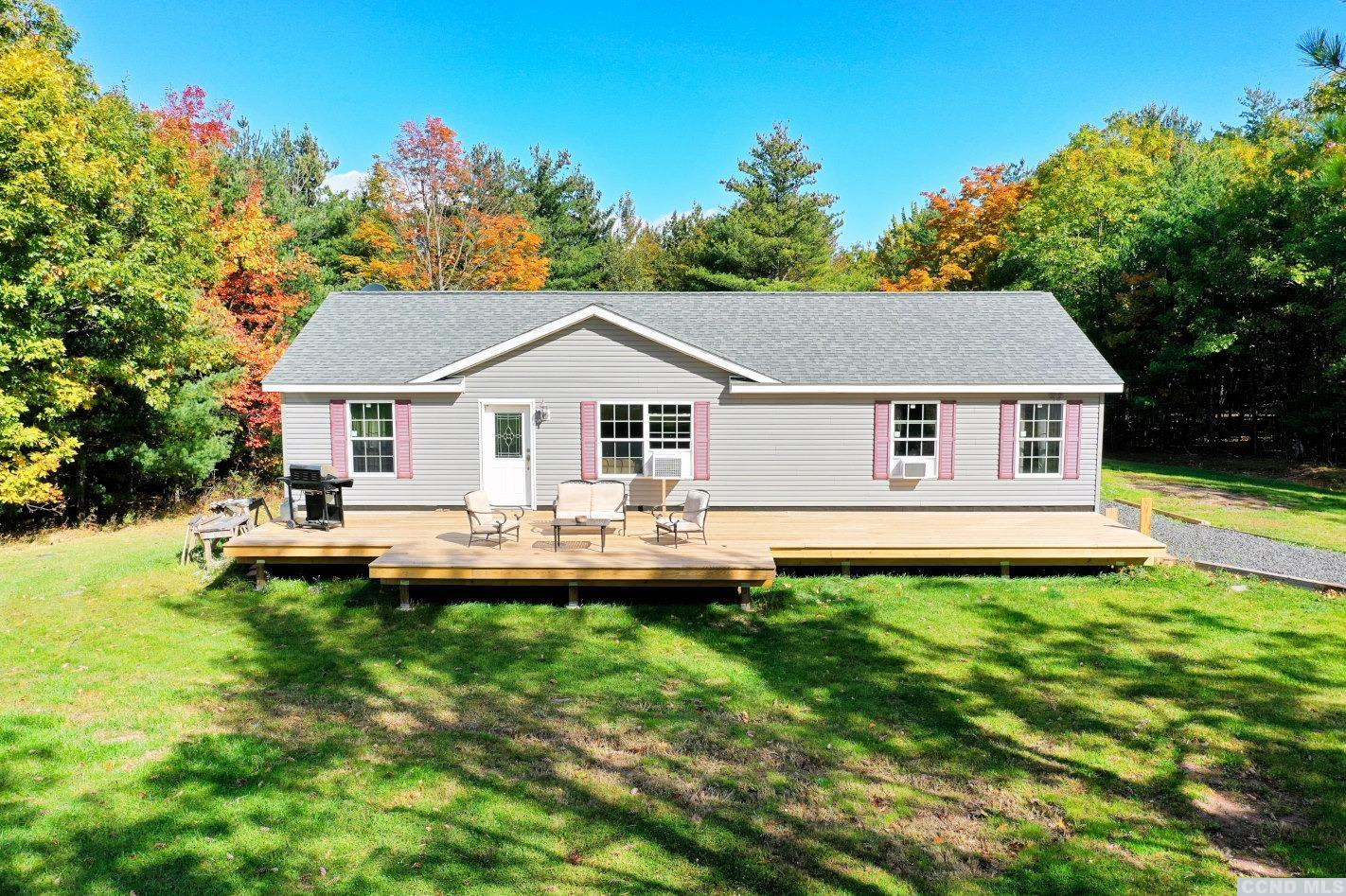 Beauty & Seclusion! A Beautiful Home & Setting Amidst 7 Private Acres. The home features 3 bedrooms - including a master bedroom & bath suite, 2 full baths, a living room, a kitchen with a dining area, a laundry room, a full unfinished walkout basement, and a large front deck. The home was built in 2013 and has cable internet. It's 15 minutes to Windham Ski Mountain and 10 minutes to Zoom Flume Water Park. It's an Amazing Property with Beautiful Landscapes & Mountain Views!