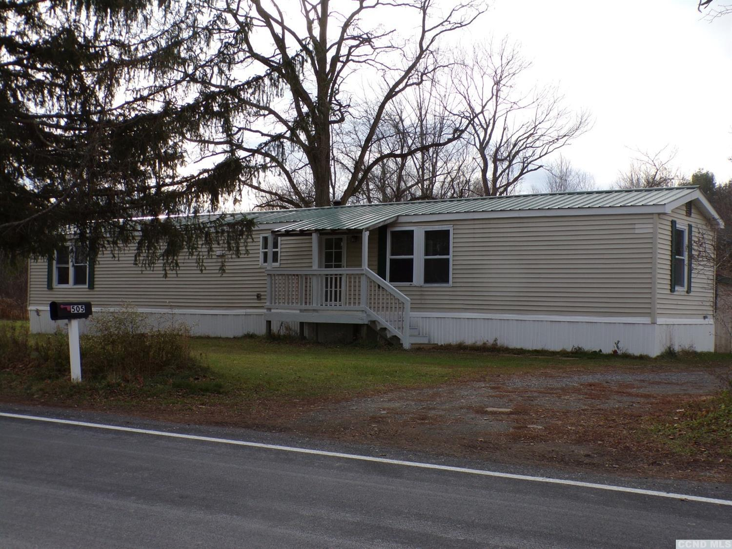 This single wide, manufactured home was completely renovated in 2018, featuring 2 bedrooms and 1.5 baths. It includes NEWER; front door, windows, carpeting, vinyl plank flooring, bathrooms, kitchen with stainless steel appliances, washer and dryer, lighting and insulation. On the exterior; newer skirting, pressure tank for the well, new oil pump and metal roof. There is a front porch, back deck, shed and access to a small pond. ALL furniture stays and new window air conditioning unit. Enjoy country living.