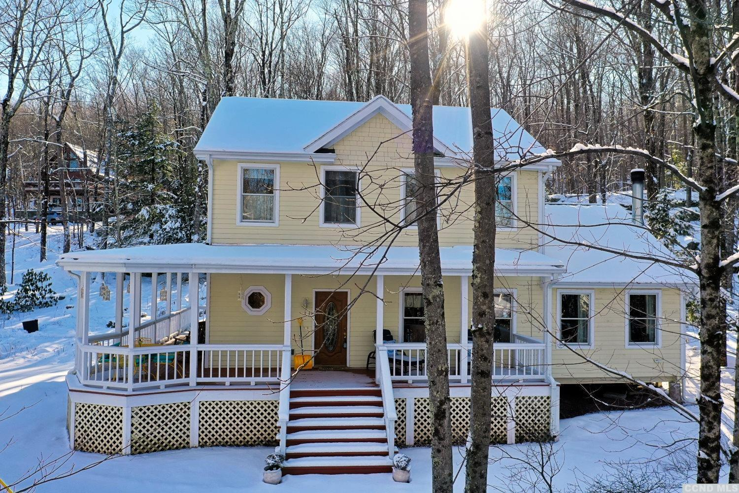 A Stunning 4 Bedroom, 3 Bath Contemporary Country Retreat in the Ski Heartland of the Catskills-Hunter Mountain! The home features a kitchen with a breakfast bar which walkouts to the wraparound country porch, a living room, a dining room, a family room with a fireplace, a 1st floor bedroom or an office, & 2 master suites on the 2nd floor. The large master ensuite offers a large bedroom, a full bath, & a large walk-in closet. There is an enjoyable wraparound country porch with a corner gazebo. The home is indeed a charming country display of sophistication & grace. The grounds offer a beautiful mountainside landscape of peace & tranquility. Sunset Park Rd is near Kaaterskill Clove/Trails: 'An area of timeless beauty & endless opportunities'. It's 10 to 12 minutes to Hunter Ski Mountain & North South Lake. The home was built in 2007 & since that time there are newer upgrades: septic system, heating system, & high-speed internet. An Extraordinary Home!