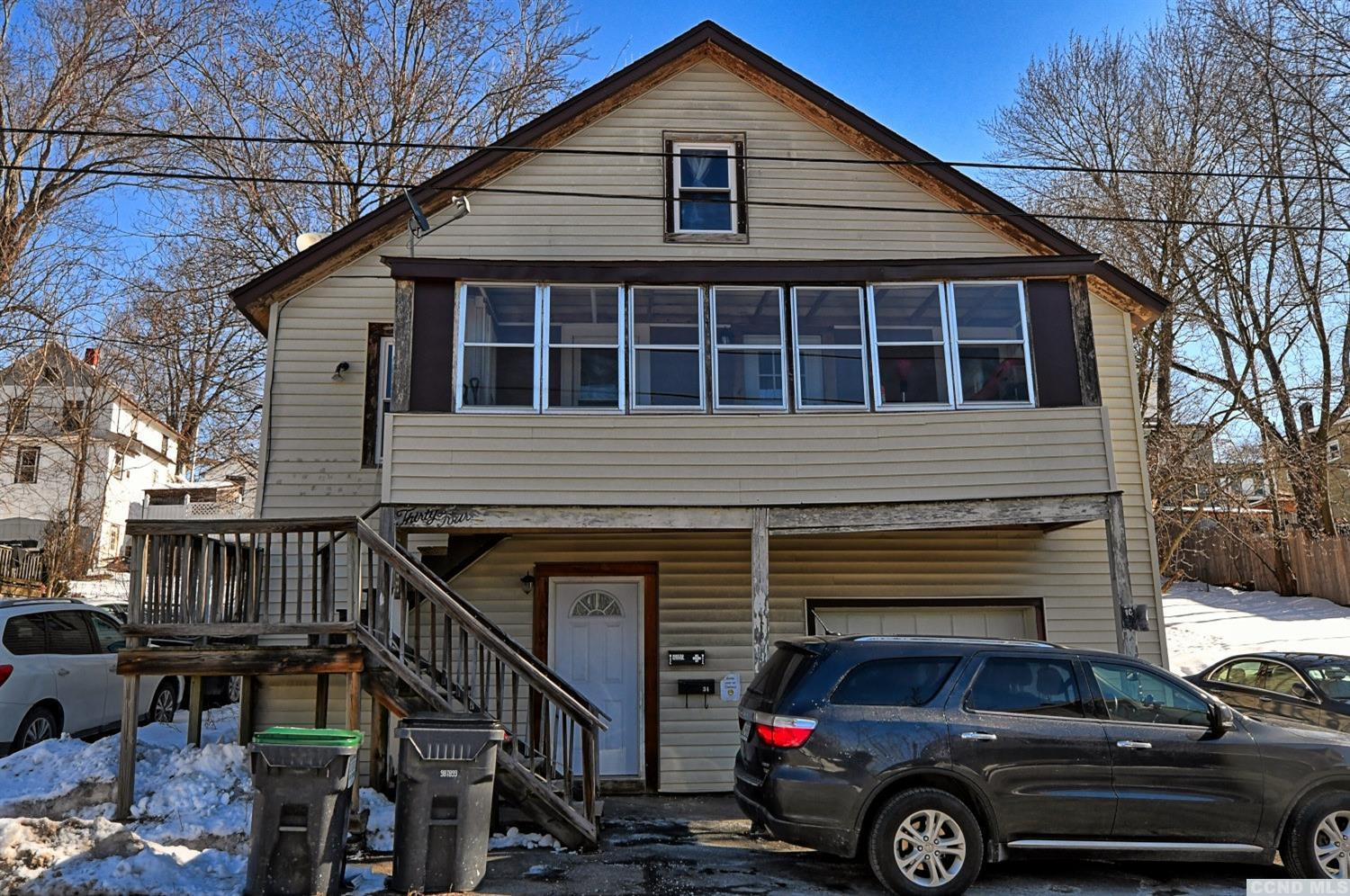 A 4 to 5 Bedroom, 3 Bathroom Home with a Garage in the Village of Catskill! The home is a single family home that has a ground level studio apartment. The ground level has a kitchen, a bedroom, and a full bath. The upstairs apartment consists of the 2nd & 3rd floors. The 2nd floor has 3 bedrooms, 1 full bath, a large living room, a kitchen, and back & front enclosed porches. The 3rd floor is utilized as a master bedroom & bath suite. There is a backyard & 1 off street parking space. The home is walking distance to Main St, the Historic Catskill Point, the Hudson River, the Catskill Creek, & more. It's a Great Village Home! A Great Mother/Daughter Home! Please view our 3D Virtual Tour of the home.