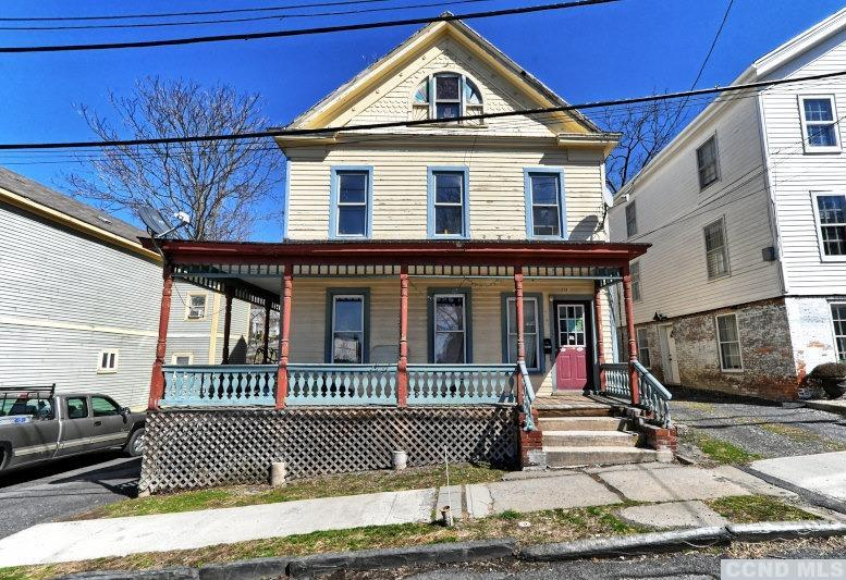 A Large 2 Family in the Village of Catskill! The first floor apartment has 3 bedrooms, a living room, a kitchen, and a full bath. The upstairs apartment has 2 floors-the 2nd & 3rd floors. On the 2nd floor there are 2 bedrooms, a living room, a kitchen, and a full bath. On the 3rd floor, there are multiple rooms for 1 to 2 more bedrooms. The total annual rent roll for 2021 is $33,600. The downstairs apartment is rented at $1,200 per month & the upstairs apartment is newly rented at $1,600 per month. There is an unfinished basement with a laundry area. There is off street parking for 1 parking space to the left of the home. It's a great opportunity in the thriving Village of Catskill!