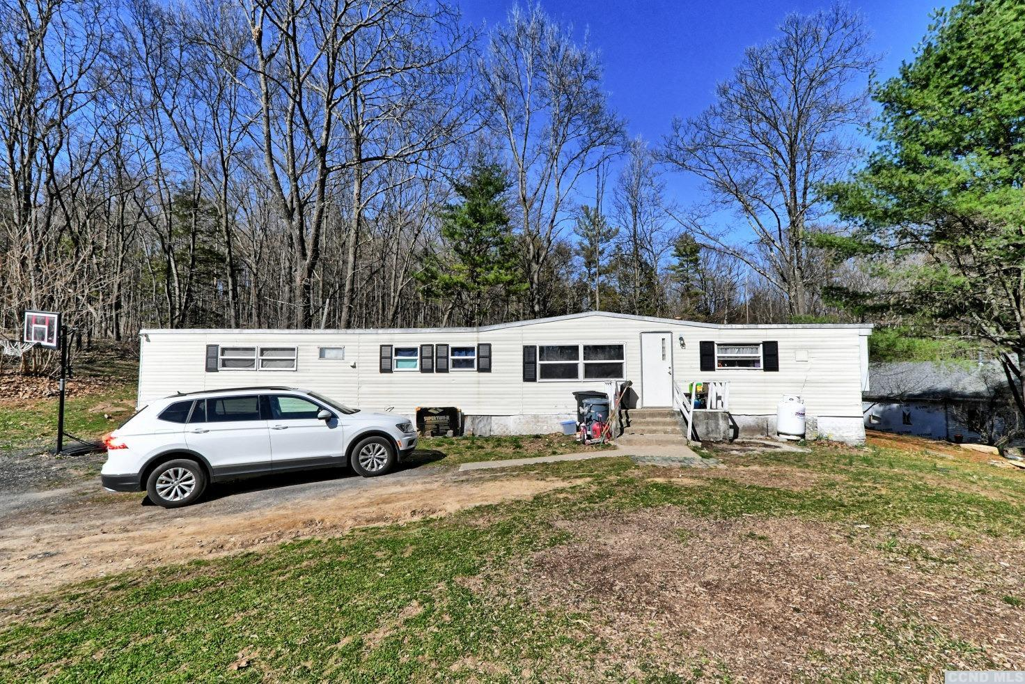 A 2 to 3 Bedroom, 2 Bath Single Wide Manufactured Home in Catskill on .45 acres. The home has a kitchen, a living room, a sunroom that is being used as a bedroom, a laundry room, & a master bedroom and bath. Minutes to the quaint Village of Leeds. 5 to 10 minutes to the Village of Catskill, and 30 minutes to Hunter Mountain. Please view our 3D virtual tour of this home.