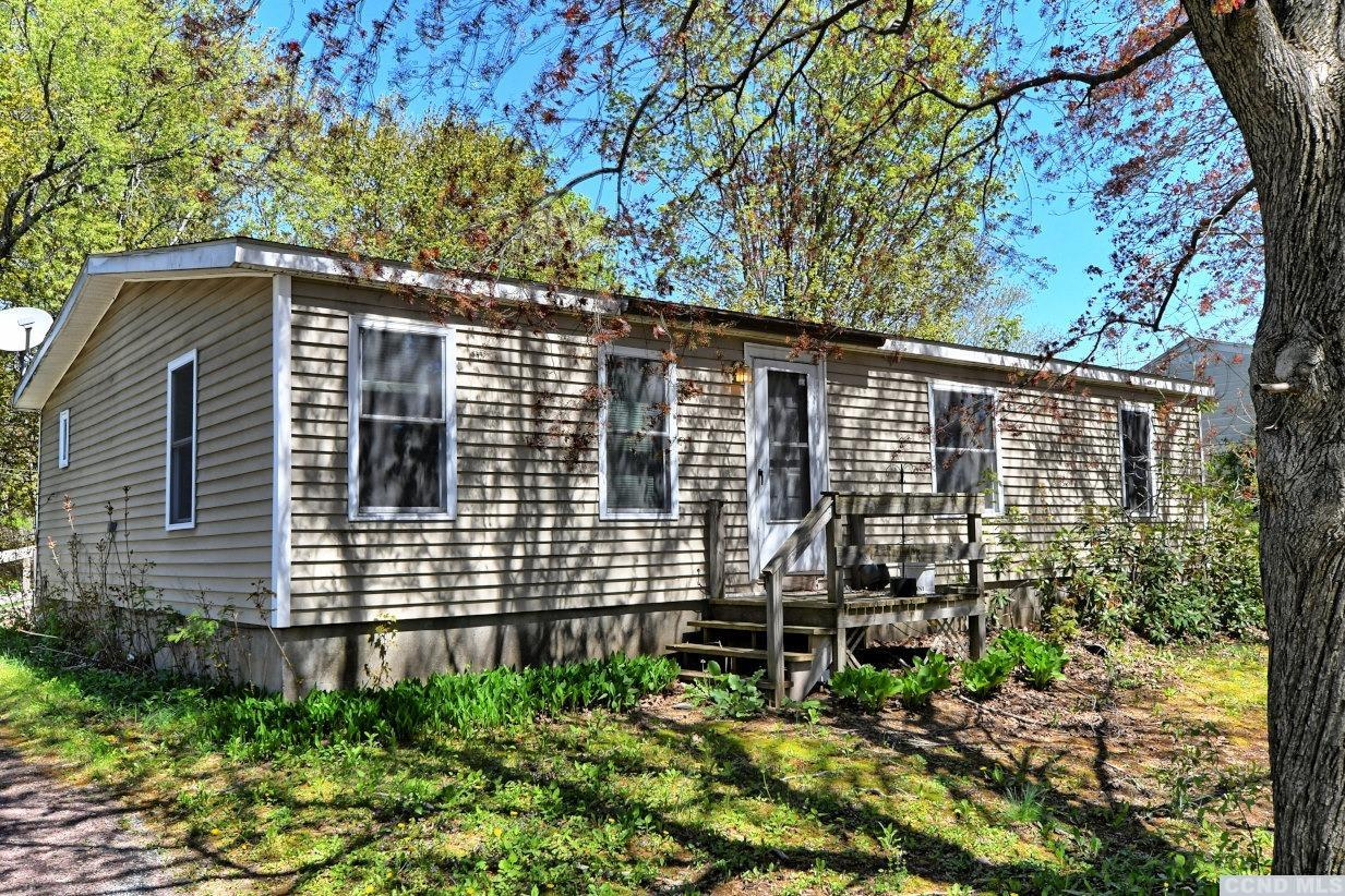 A 3 Bedroom, 2 Bath Double-Wide Manufactured Home on .45 Acres. The home has a master bedroom & bath, a living room, a kitchen with a dining area, and a laundry closet. The home needs attention. View our 3D virtual tour of the home.