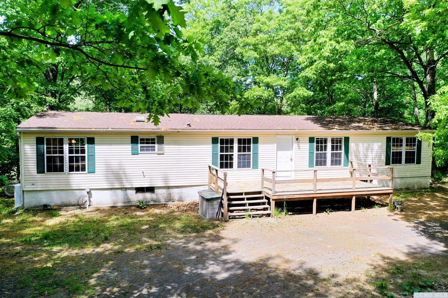A Large 3 Bedroom, 2 Bath Double-Wide Manufactured Home in a Beautiful Setting on 1.5 Acres! The home features a master bedroom & bath, a living room, a family room, a dining room, a separate dining area off of the kitchen, a laundry room, and a 2 car garage. The home without the horse barn in the back of the home is listed at $179,900. The home with the horse barn is listed at $199,900. The seller is working with a surveyor to update the survey and confirm whether or not the horse barn is on the subject property. Please do not drive down the driveway. There is a shared driveway with 2 homes and gated access to this home. Appointments only for visits. It's a Nice Home in a Beautiful Setting! View our 3D virtual tour of the home.