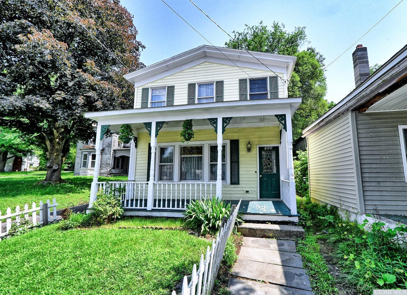 A Charming 2 Story, 3 Bedroom, 1 1/2 Bath Home in Cairo! The home features 3 to 4 bedrooms, 1 1/2 baths, a living room, a dining room, an eat-in kitchen, back enclosed porches on each floor, & a 1 1/2 car garage. There's a front covered porch, a large rear yard, & a driveway for off-street parking. It's walking distance to the local shops, eateries, the Cairo Public Library, & Angelo Canna Town Park. It's a Charming Home on Main Street in Cairo! Please view our 3D virtual tour of the home.