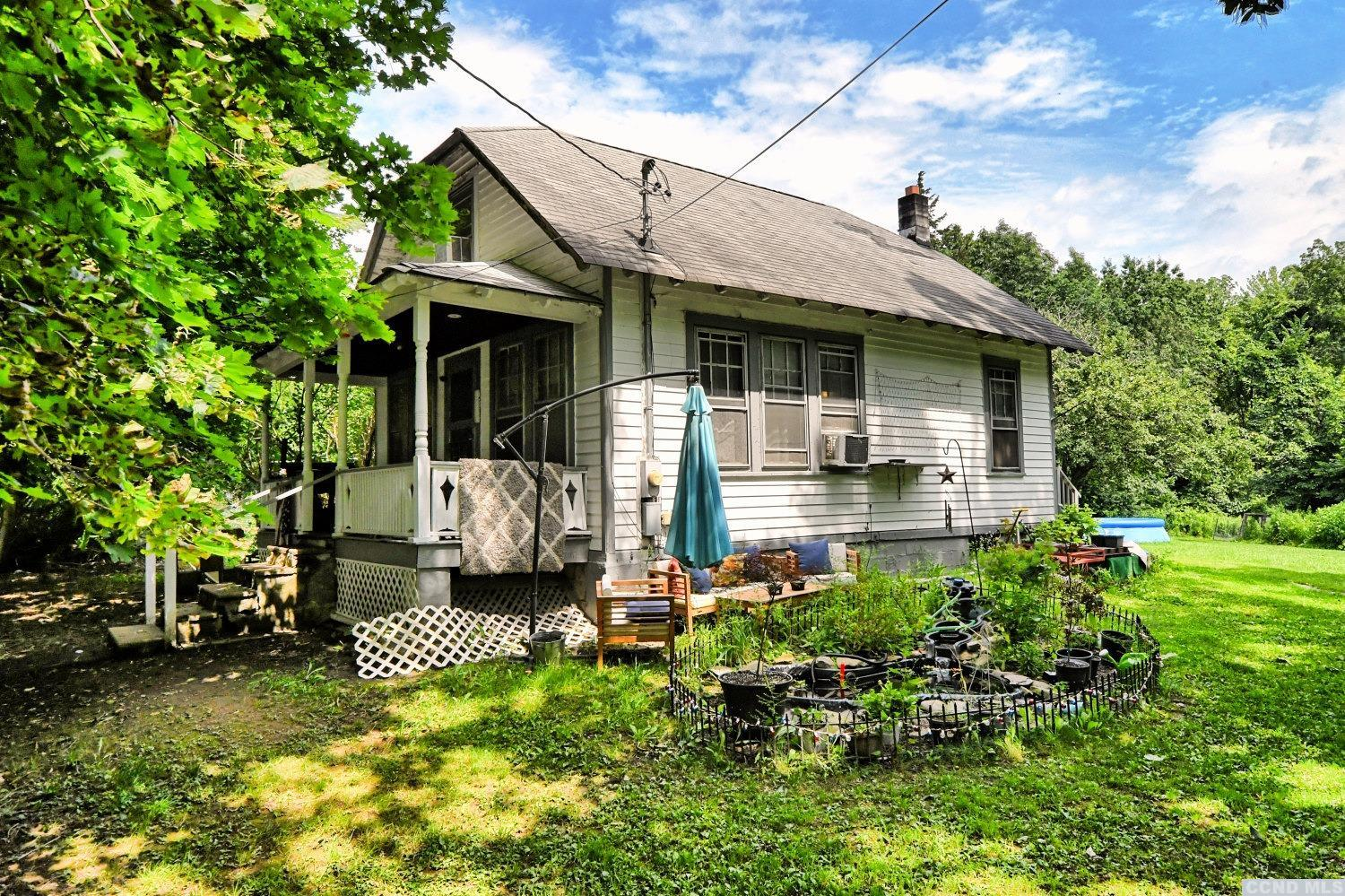 A 3 Bedroom, 1 1/2 Bath Home on 4 Acres with a Cabin & a 2 Car Garage! On the 1st floor, the home features 2 bedrooms, a living room, a kitchen, & a full bath. On the 2nd floor, the home features 1 bedroom and a 1/2 bath. The home has a front covered porch, spacious side and rear yards, a 2 car detached garage, a cabin or a shed, and a small seasonal stream. Please view our 3D virtual tour of the home and property.