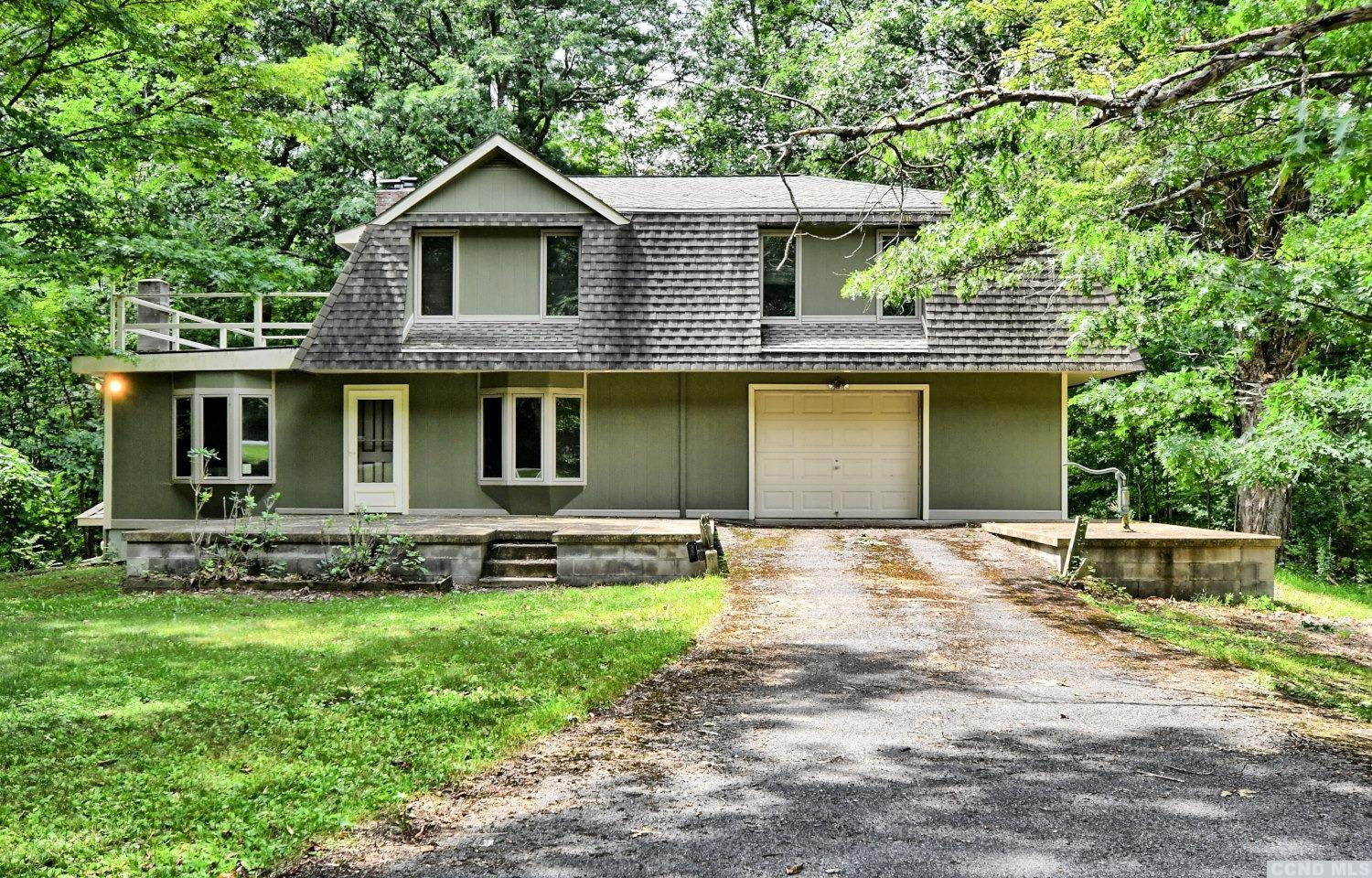 A Beautiful 24 Acre Parcel of Land with a 4 Bedroom, 3 Bath Home! The land features a pond, a creek, & privacy. The home features 4 bedrooms with a master bedroom & bath, 3 bathrooms, a spacious living room with a wood stove, a dining area, a kitchen, front & rear patios, a back deck, a 1 1/2 car garage, and a paved circular driveway. There's central air conditioning and the foundation is insulated with Zonolite Masonry Insulation. The pond is behind the home and the Plattekill Creek is at the back of the property. It's an Amazing Property & Home! Please view our 3D virtual tour of the home and property.