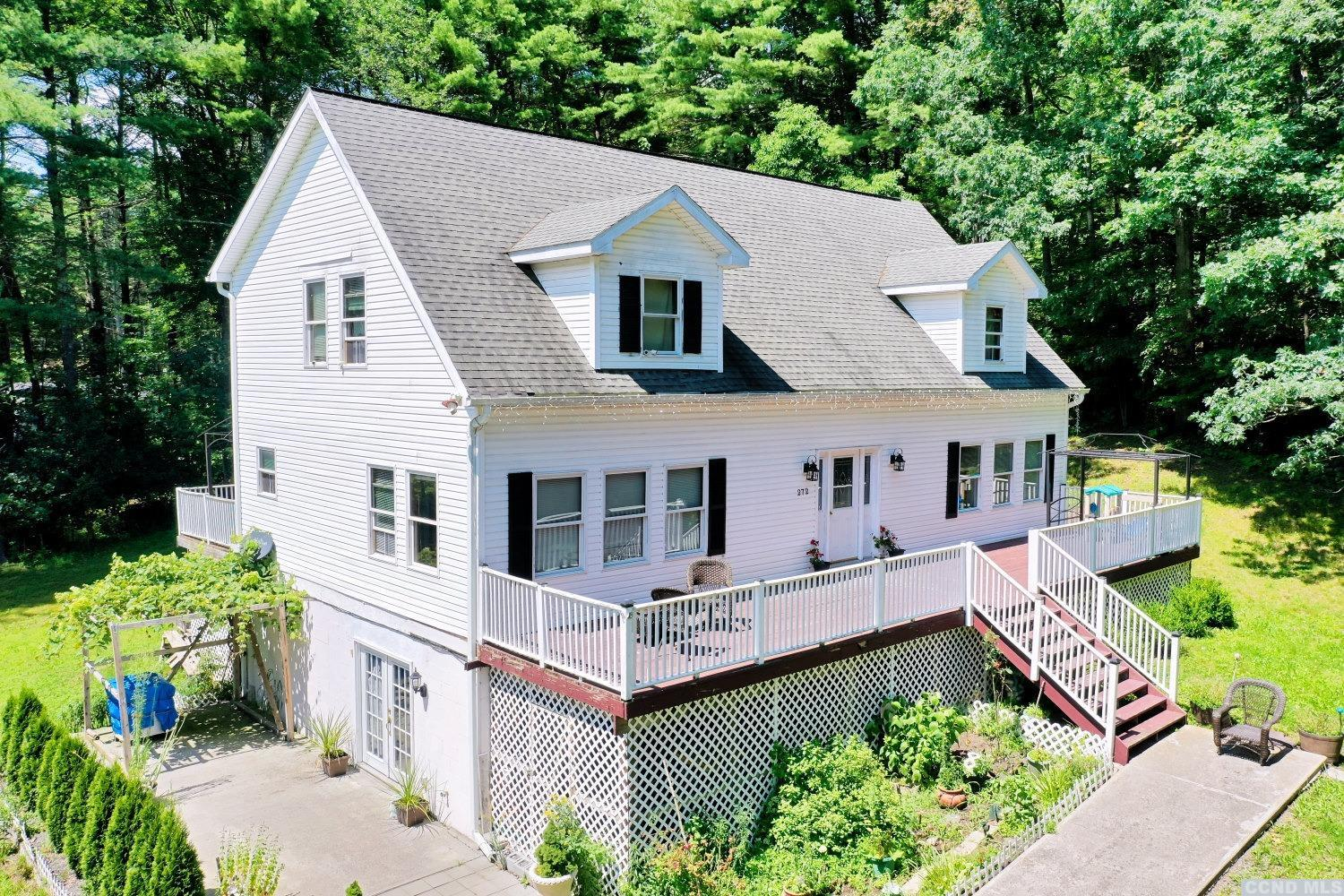 A Beautiful Home & Secluded Setting with 3 Bedrooms & 2 1/2 Baths on 2.3 Acres! The home features a master bedroom & bath ensuite on the 1st floor, a large kitchen with a breakfast bar & center island, a dining area, a living room, 2 bedrooms and an office on the 2nd floor with a large Jack & Jill bathroom, a full walkout basement with high ceilings, a 2 car garage with a room on the 2nd floor. There is a patio, front & rear decks, landscaping, yard space, a shed, and a small stream. The home has an inviting kitchen, a comfortable living room, a laundry room, rooms off of the 2nd floor bedrooms, an unfinished basement for additional living space, an oversized garage, a 2nd floor unfinished walkup in the garage for a studio, additional living space, or a larger office. It's a Delightful Home in a Graceful Setting! Please view our 3D virtual tour of the home & property.