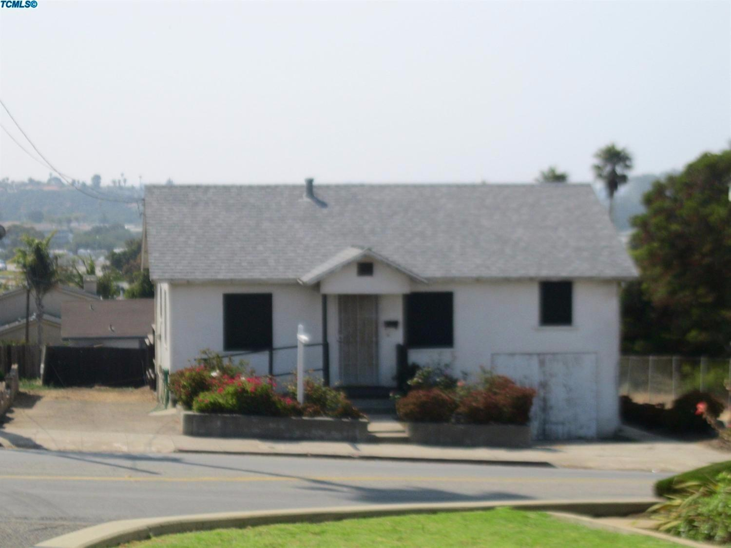 ZONED R-1 - R-3, Zoned for 4-5 Condos. Lg double lot. Ocean View ! 3 Blocks away from Beach, Pier, Restaurants & Shopping!! GREAT OPPORTUNITY to develop Condos/Pud 4-5 per City of Pismo. New Condos/Pud could have beautiful ocean views. Charming house to rent while you process your project! 3/1 bedroom over the garage with sink and cedar closet. Has deck that is wheel chair accessible. Call for more information.A conditional use permit in existing zoning could be obtained for another project per city of Pismo approval. Level 1 water moratorium has been lifted!