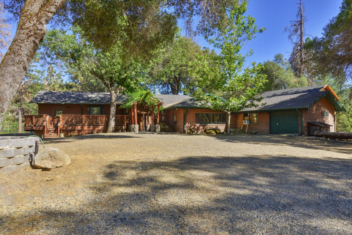 1st class Country Estate on an approx. 9 acre private lake! Located on 32.43 beautiful acres with pines, oaks & manzanitas at approx. 3000 elevation and only 3+/- miles to Bass Lake. This inviting country home is approx. 3800SF (per seller), split level featuring 5 bedrooms and 4 bathrooms overlooking a built-in pebble tech pool & spa and boat dock on the lake. It doesn't get any better than this! Ideal property for horses, vines and/or an orchard. Only 5+/- minutes to Oakhurst. Ideally located. By appointment only. Currently a vacation rental with rental income! An indoor/outdoor game room, a guest house and a huge deck to enjoy the lake, pool and life!! Definitely one of a kind!!!  Buyer to verify square footage if concerned.