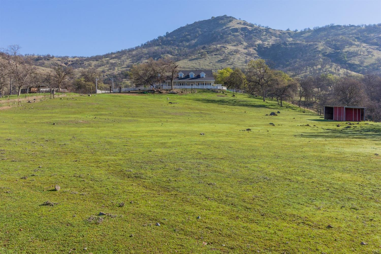 Rare 98 acre property backing up to thousands of cattle land acres which offers extreme privacy and spectacular views, yet has easy access and is just 35 minutes from the city, 35 min to the airport. Add to this the extremely well built custom home and you have a one of a kind estate. Imagine sitting on your 50'long cov'd front porch & overlooking your gorgeous property and views below.  The seller overbuilt w/commercial wiring, 2x6 construction, extra strong insulated subfloors and many other upgraded features.  There are built-in cabinets/shelving, functioning dormer windows and ceiling fans throughout. There's a year round spring & season creek too.