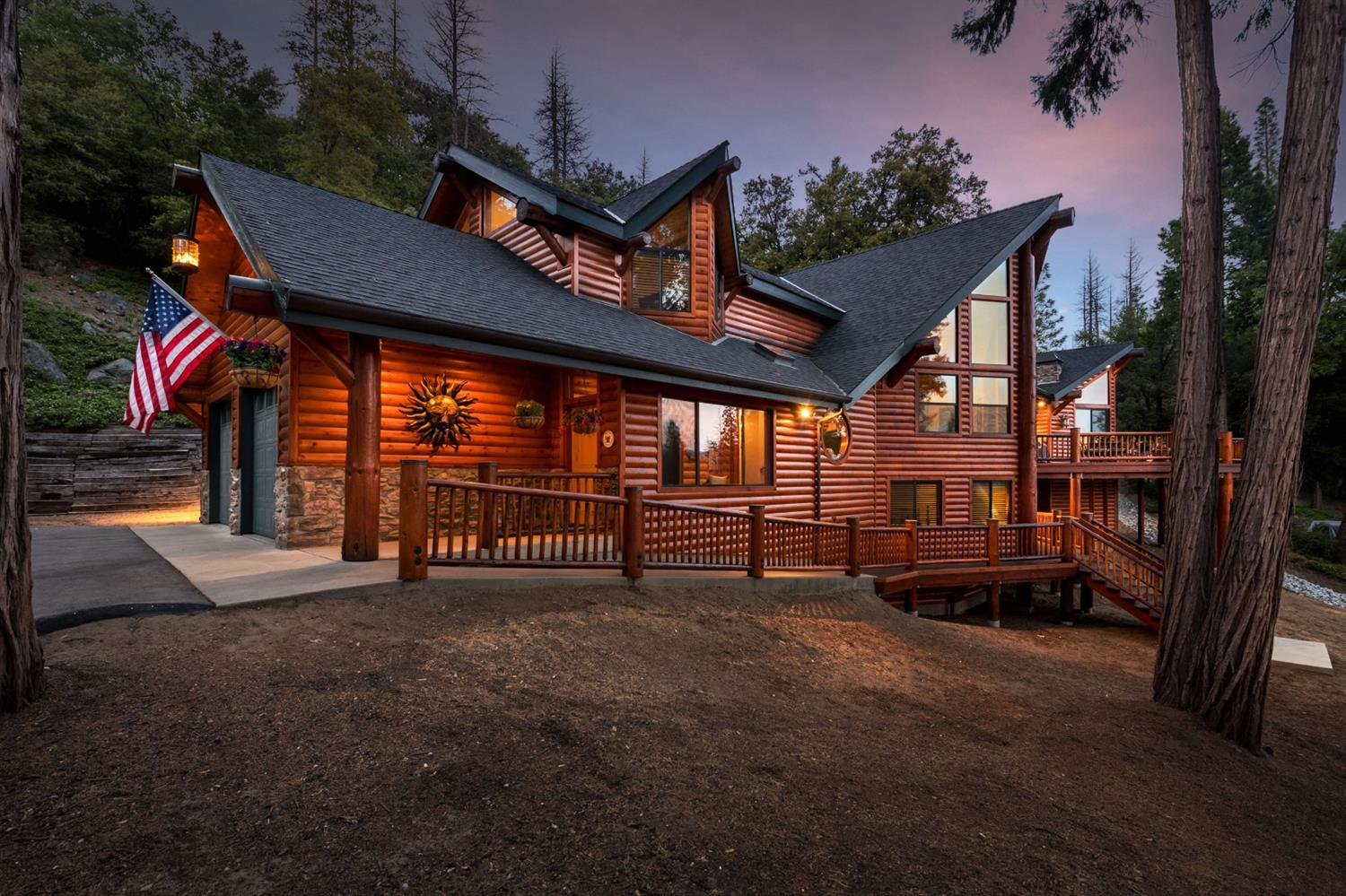 This beautiful home combines mountain cabin design and modern luxury with distant mountain views on 10 quiet, private acres near Shaver Lake. The spacious great room with 22' cedar ceilings & log siding has room for large gatherings. The kitchen is new with knotty alder cabinetry; Italian granite; SS 48 commercial range, microwave drawer, refrigerator & dishwasher. The private, spacious master suite with propane stove, natural stone hearth, log ceiling treatments and luxurious bathroom are on the main level. A second master suite is upstairs, & 2 large bedrooms and full baths are downstairs & half bath off the laundry room which has new cabinetry & granite. The loft is a great office or kids play room. The den is the TV room with a pressed metal & captains beam ceiling & propane stove with natural stone hearth. The deck with fire pit is large. The hidden 750-bottle wine cellar is gorgeous. Garage fits large pickups. The shop has a 3/4 bath, 220 & heater. 20+ GPM well. Watch the video!