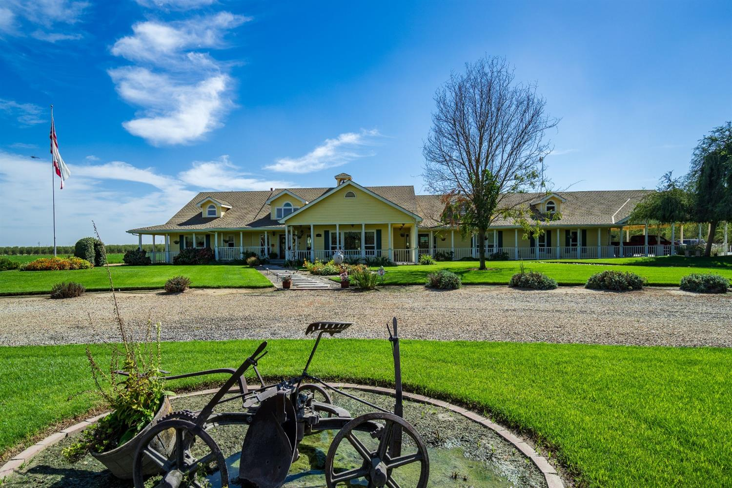 !8.66 acres, a Fabulous 5200sqft custom home with every feature I have ever seen, aprox 15 ac in Alfalfa, FID water, 2 - 75x40 steel buildings, fenced areas for equipment/hay storage, entertainent. This is the peak of elegance,entertainment, farming, business life and Family.