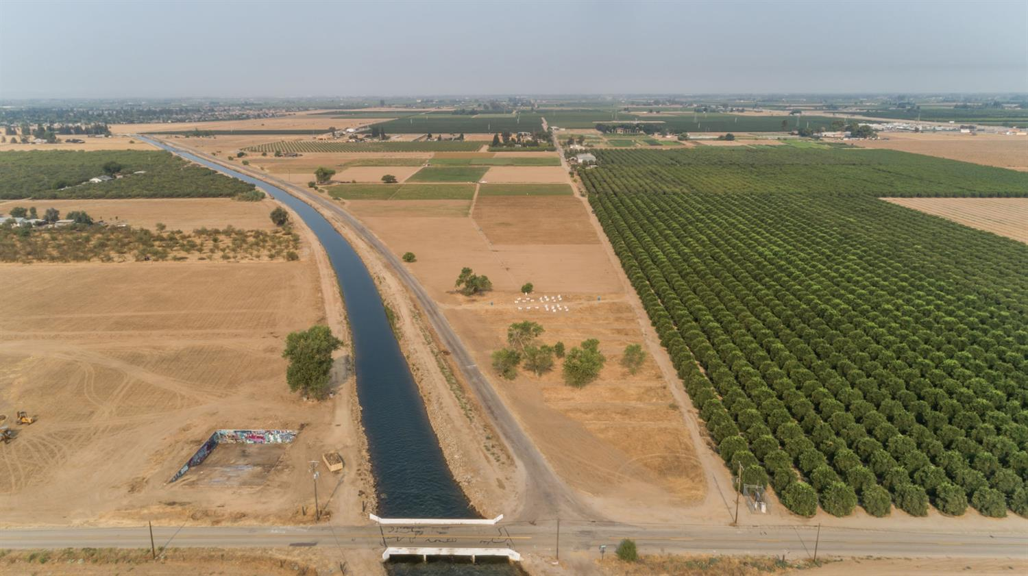 40 Acres of Open Land and currently on a short term lease. Ag well and Kings River Consolidated water. Property has electric and septic hookups from previous home on property. Proposed annexation into the City of Sanger sphere of influence and Residential high density zoning.