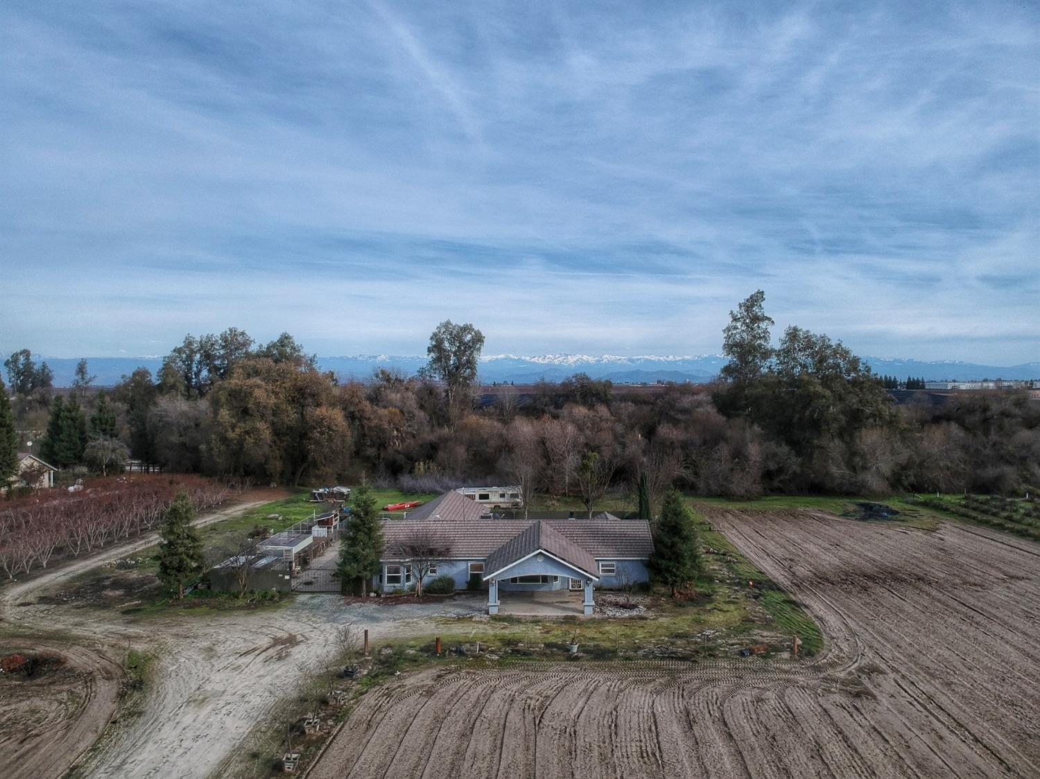 Here is your chance to own Riverfront property in the Clay school district! It is not often that these types of properties hit the market. Don't miss your chance. This property consists of 8.07 acres with aprox 5 acres open for planting. There is a custom home on the property that was built in 2001. The home has a split floor plan with 3 bedrooms and 2 1/2 baths. There is also a 4 car garage. Near the road is an older Mobile home and garage  that needs to be refurbished but would make a great mother in law unit or rental unit. This property has 347 feet of River frontage! There is a lagoon that will allow you to park up to 4 boats and a boat house down by the water. The boat house needs work but has a kitchen and 1 bedroom with a large covered deck. Imagine the fun you could have at this wonderful property! Great location near Mt View Ave with easy access to the 99 freeway. Call you agent today to see this property!