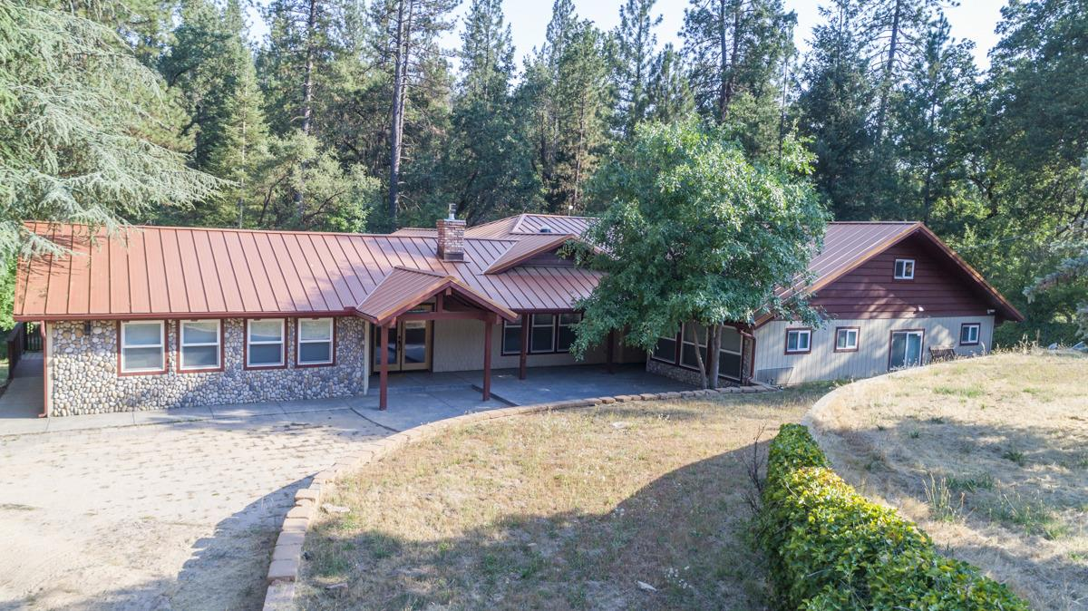 A country estate on Nelder Creek! Ideal private location on 5.47 acres between Bass Lake and Oakhurst. This home has a large deck and large spa, all overlooking the creek! Hear and see the running water to totally relax you. The home is state of the art 3722SF featuring 5 bedrooms, 4 baths, vaulted ceiling, wood & ceramic tile floors, a great room concept and a separate recreation room. The kitchen is incredible with all stainless steel appliances, ice maker, wine cooler and country style farm sink. A large separate 4 car garage, enough to park 7 cars depending on their size. Located among pines, oaks and cedars @ approx. 3000 elevation. Living the good life!! By Appt. only. Beds & baths are different than county records. Buyer to verify if concerned.