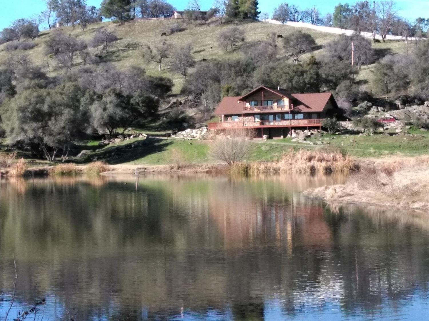 Own your very own private lake! This 6500 sq. ft. home sits on 58+ acres. Additionally, there is a very nice guest, ranch hand modular home. This property has an abundance of wildlife and families of geese that return home annually. The home is expertly designed for lots of family and friends to enjoy, with 5 BR and 4BA. Almost every room has a unique design made of wood inlaid in the ceiling. Spacious, sunlit rooms with awesome views are a must see. Ground level features a multi car garage with storage rooms. There are barns that are perfect for horses, storage, or work areas. Beautiful decks overlook the sparkling lake. Gated entrance. Deer blind. Pig feeder. Shooting range. RV hookups. Hunting. Fishing. Horse riding. Quads, and more.