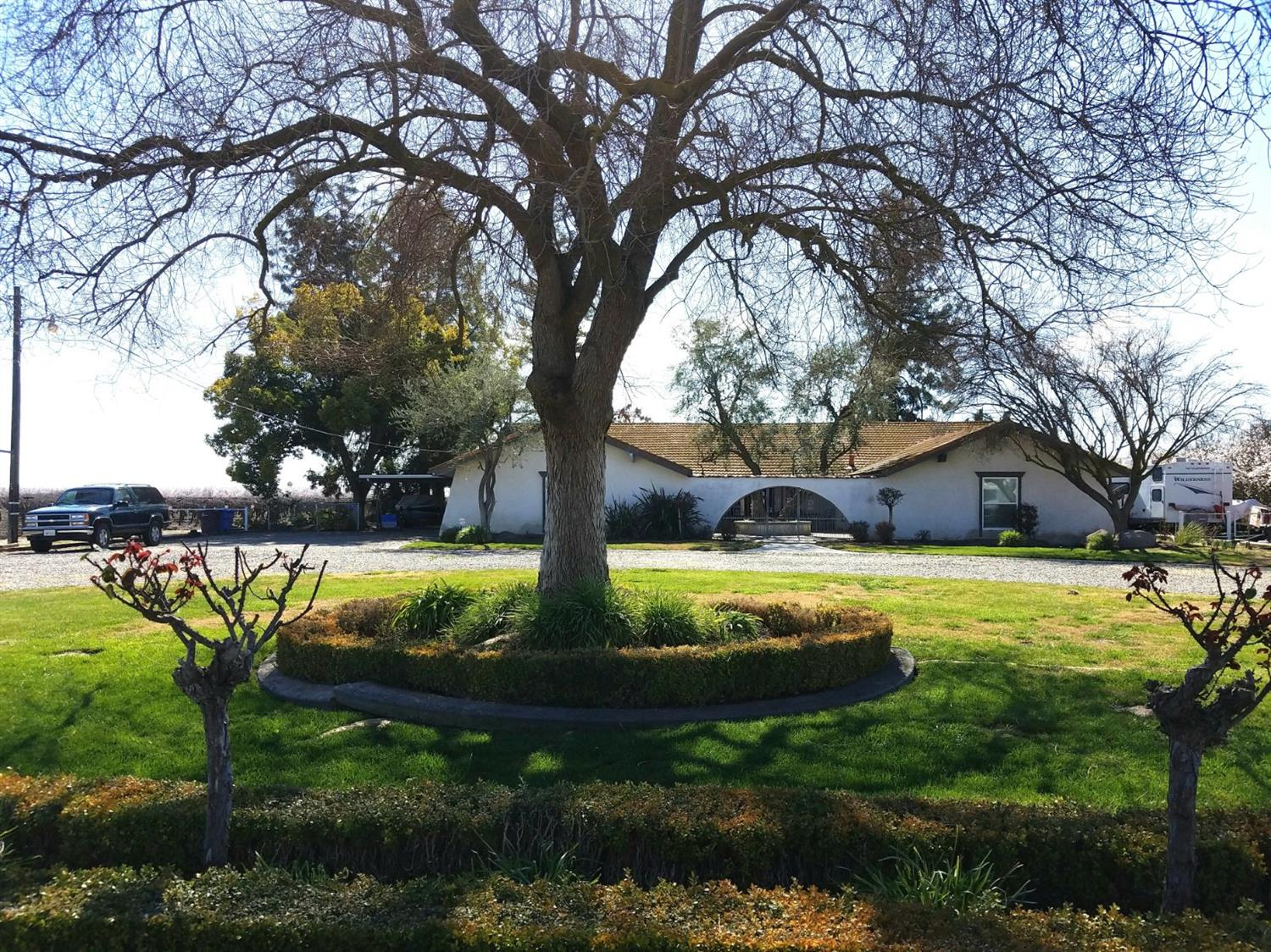 WOW! This is a rare find in the county. This beautiful Spanish style home has 1.41 acres.  This home has an amazing backyard with a pool / spa and mature landscaping. There are a few Almond trees on this property that you may enjoy farming. The inside of the home has been wonderful well maintained and has a stunning courtyard as your entry.
