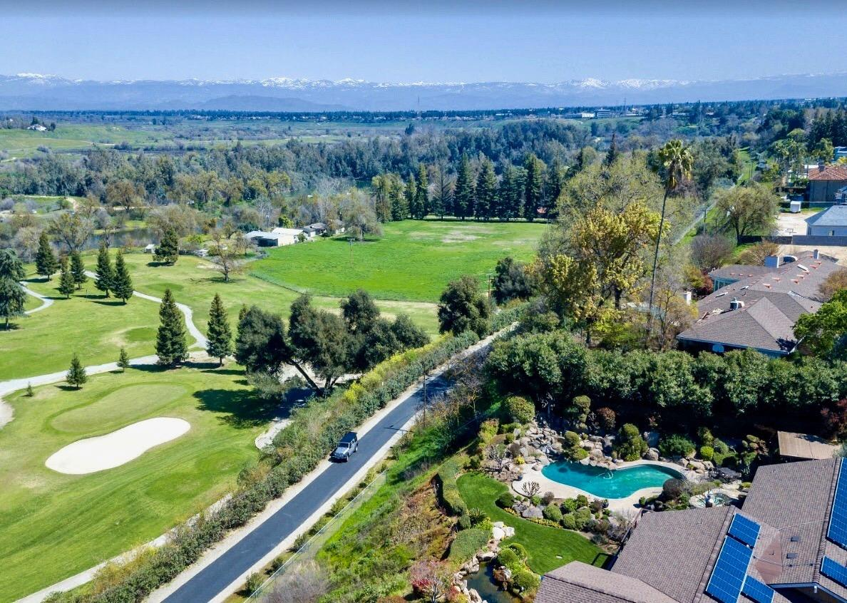 Here's your chance to own a very RARE Van Ness Extension, River Bottom GEM! This beautiful 10+/- acre property is located just off of the 17th Green at Fig Garden Golf Course. Enter the property through a beautiful private gate and feel immediately like you are in the Coastal mountains. As you follow the beautifully landscaped road down to the property, the subject property is situated directly below the road to the left. This property features roughly 10 acres with 3 Homes, 2 Barns, River Access, Fruit trees, Olive Trees, a horse Stable and the list goes on and on. Here's a BONUS! It is situated in the Award winning Clovis Unified School District! The opportunities with this property are absolutely endless but you need to come experience the River Bottom for yourself. This is a once in a lifetime opportunity!