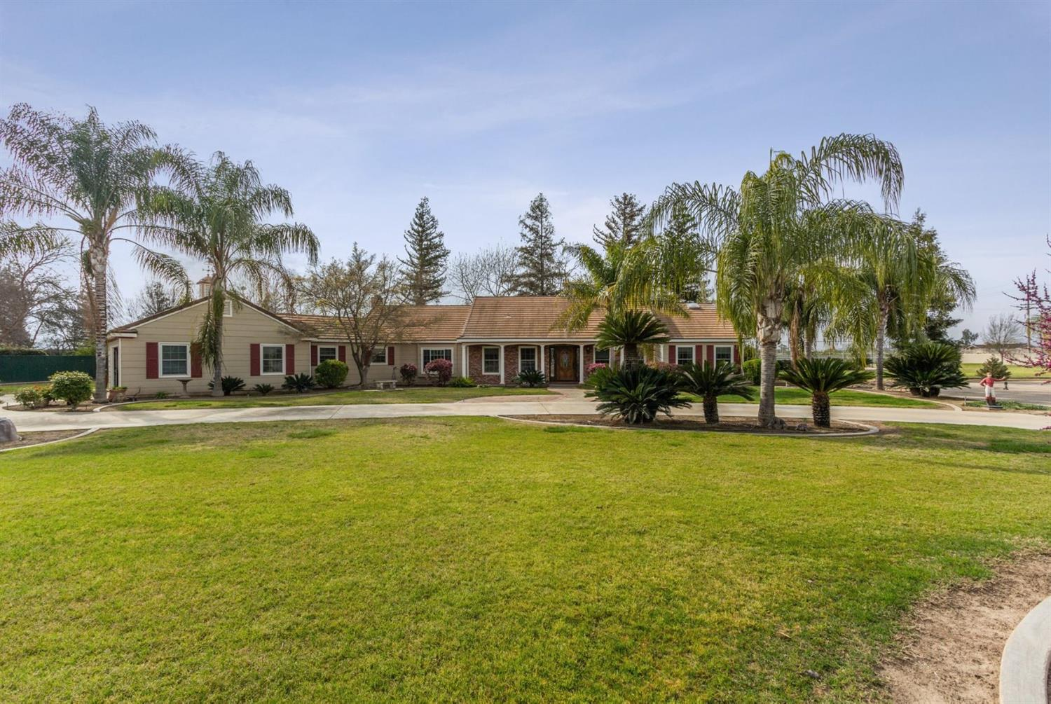 Live and Play in your very own Country Park, just minutes from the city of Dinuba. Great home for the active family and an amazing set up for entertaining!  2.78 Acres of gorgeous matured landscaping with a 2600 sq ft main house, 1200 sq ft guest house, and an ultimate back yard with a tile floor, covered patio, outdoor Kitchen/Brick BBQ, full size tennis court, and over an acre of lawn.  This huge back yard is perfect for family fun, holidays, or little league practice.  Don't let the evening slow you down, commercial lighting will keep it going on the tennis court or on the grass field.  Main home is 2600 square ft. 3 berm, 2.5 ba, office , formal living room with coved ceiling and wood beam and fireplace, formal dining rm, & family rm., Marble tiled floors, granite counter tops  1200 sq. ft. guest or in-law house with entry doors, second home includes 1 bedroom, living room, office, kitchen & full bath, laundry hook up and RV Parking garage.