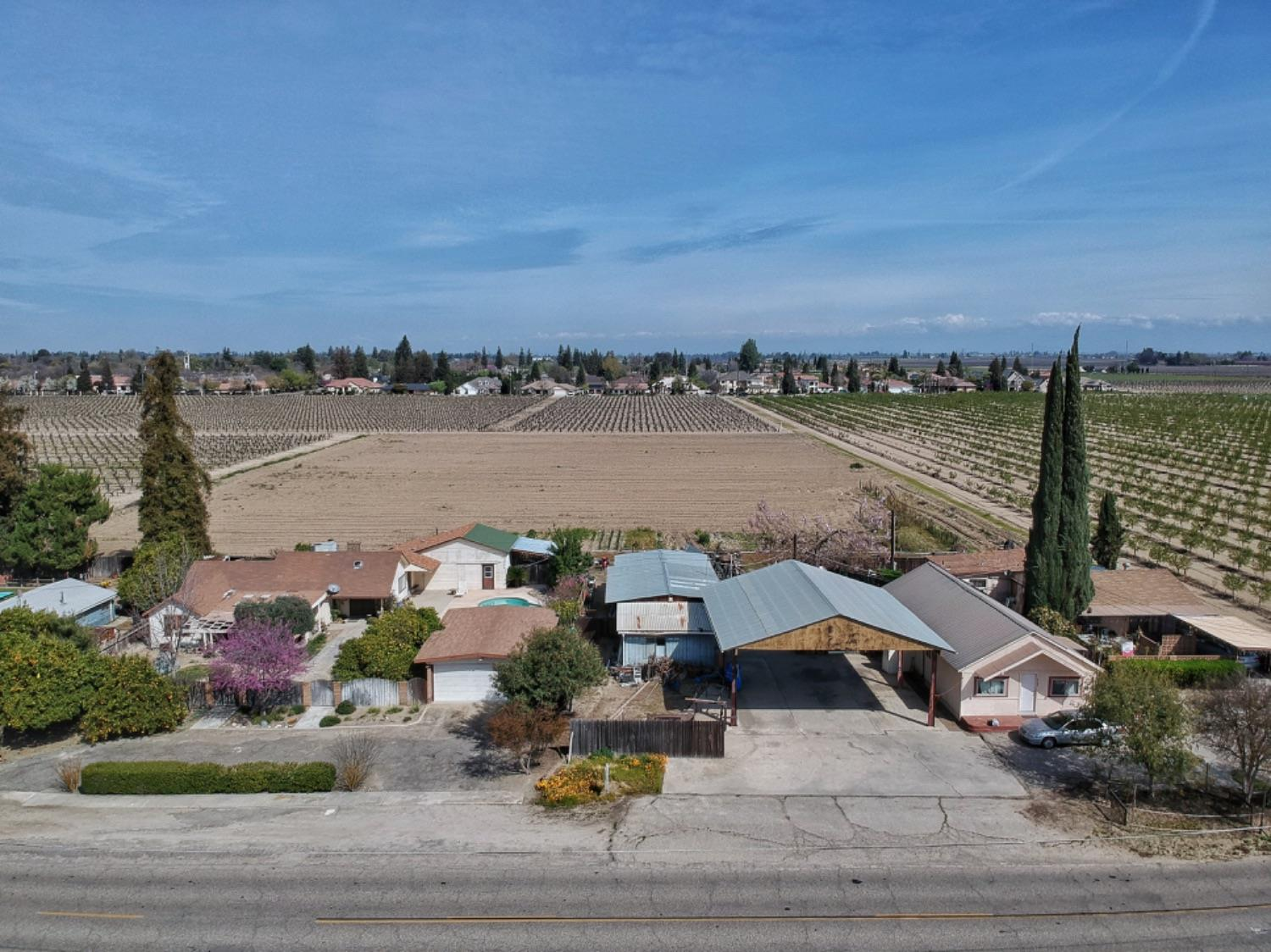 3 houses included in sale plus outbuildings and 3.67 acres open ground.  Four APN but all sold together.  All houses total 3,429+- square feet.  Built in 1920, 1940 & 1950.  Total land equals 4.51+-acres.  Buyer to verify. Live in the main house and rent the other 2 houses and lease out the land.  Drive by only without appointment.