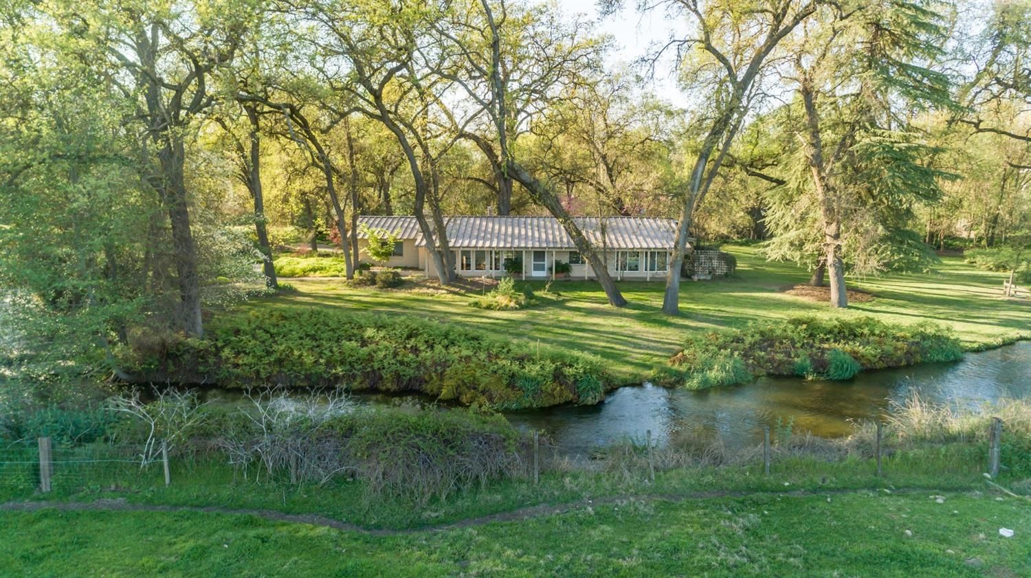 An exceptionally rare opportunity to own 13.85 acres along the King's River! The land offers  stunning views of the river & Sierra Nevada mts, grand oak trees, cottonwood trees & other  varieties, pasture or farmland, barn, raised flower beds w/ lettuce & strawberries, variety of  fruit trees & wildlife. The cozy 1,890 sq ft home showcases the land with large windows &  vaulted ceiling. Imagine opening your windows to hear the river flowing & birds chirping while  soaking in the sights. It's truly an outdoor sanctuary with limitless potential.