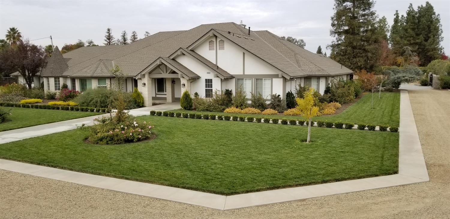 Single story 4,365 sq.' 4bed/3.5 bath home on 2.3 acres in Clovis Unified!  Four car garage is 1,400 sq.' w/ half bath. Separate garage is 1,540 sq.' w/ 13' high RV/boat storage, 2 car garage, storage room, plus 360 sq.' apartment w/ full bath. Eco-friendly acacia hardwood floors cover most of home. Roof installed May 2018.   Kitchen: Calacatta Oro marble, La Cornue 5-burner gas range w/ 2 convection ovens, 48 Sub-zero fridge/freezer & plumbed area for built-in coffee machine.  Kitchen opens to living room with 20'+ ceilings & gas fireplace.     Master Suite: access to spa pad, heated tile floors, His closet hidden behind a bookcase door & 190 sq.' Hers closet. Interior design by Erin Melkonian Interior Design.   Garden: granite paths to oak trees, animal pens, barn, and orchard/vines. Conduit laid for future landscaping lights. Landscape design by Lee Duckering.       Some items may not have been permitted.