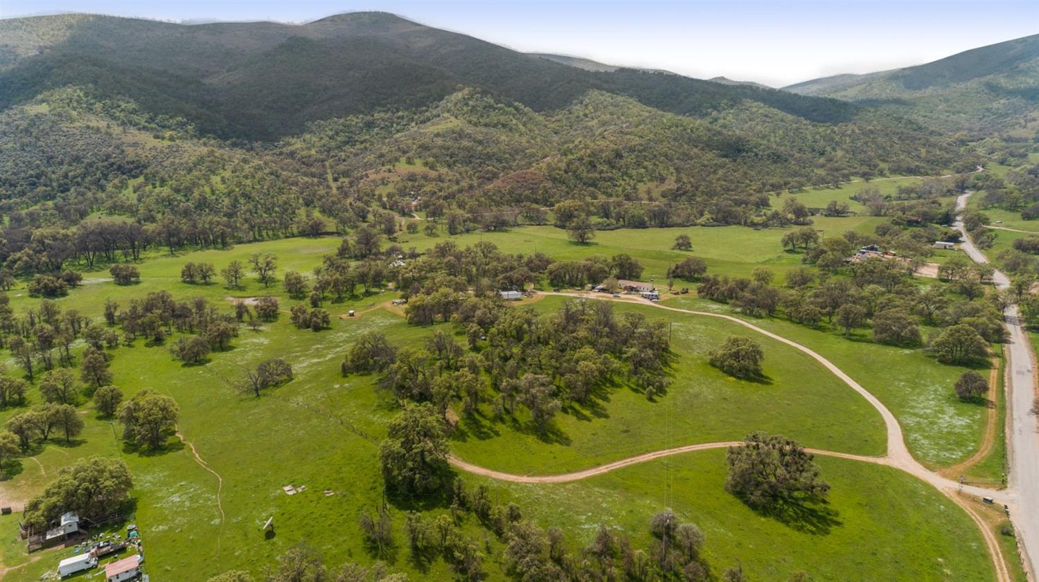 Three parcels of amazing ranch land totaling 274.35 acres, with two homes, barns, a 24x48 shop and a seasonal creek, the opportunity to own this type of ranch doesn't come along often!  One home was built in 1968, is 1401 square feet and 3/2, the manufactured home was built in 2008, is 4/2 and 1800 square feet. Two wells, 1 spring, a runoff pond, two barns and a small set of corralls, and about 5 acres of irrigated pasture. Fenced and cross fenced for livestock, the land is breathtaking.