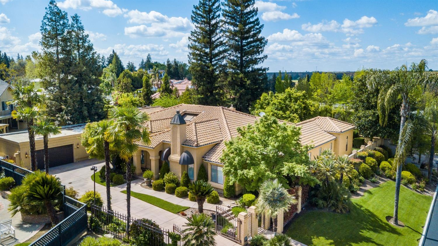 This Elegant gated home is tucked away in a quiet NW neighborhood cul de sac. A remodeled gourmet kitchen with granite counters, farm style & veg sink, gas cooktop with pot filler, pantry, breakfast bar and large eating area are open to the fabulous great room with a beautiful brick fireplace, entertainment wall which conceals a walk-in wet bar with custom cabinets & as a bonus, a glass walled serene indoor atrium, which is also viewed by the formal living & dining room. A spacious master suite offers a view with sliding glass door to lush yard, high ceilings, two walk-in closets & private bath with jetted tub, shower and db sinks. Two spacious guest rooms share a bathroom with db sinks and shower over tub. An isolated 4th bedroom is designed as an office.The backyard wraps around the house and offers a variety of plants and trees, a shimmering pool & water fall,& cabana. A 4+ car garage (1584 sq ft) offers walk-In storage & built-in workbench with cabinets. Call today!