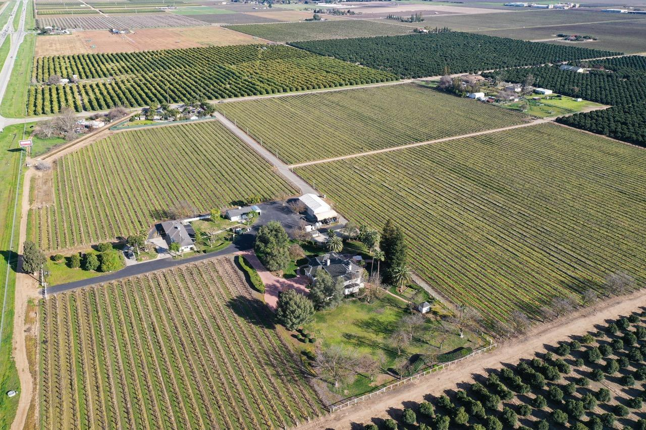 Country living at it's finest! Here is your chance to own 35+/- of producing vineyard + 3 homes on one lot! This property includes an almost 4000 square foot custom home, a 3 bedroom 2 bath guest house and a 2 bedroom 1 bath rental home. This would be an ideal setup for those accommodating a large family or multi-generations.
