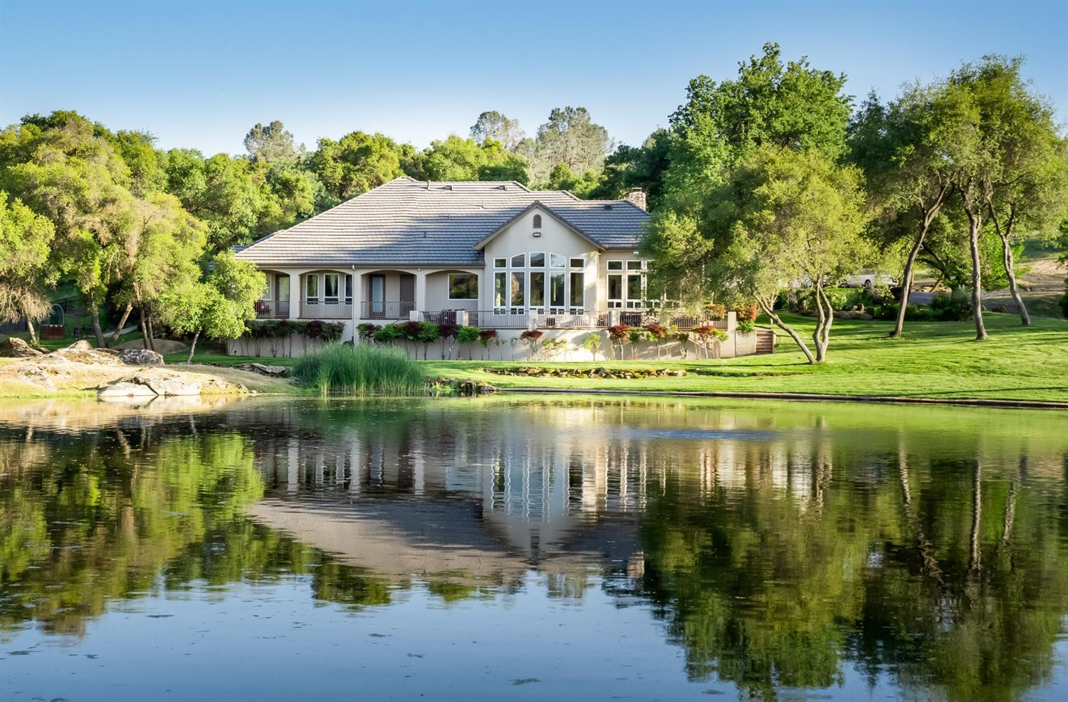 This stunning residential provincial estate is nestled in a harmonious rural setting spanning approximately 120 acres on two contiguous parcels. Embraced by a region known for premium terroir, renowned vineyards, and Mediterranean climate, this property endows a unique agriculture opportunity and development potential. Diamond Springs Ranch is suitable for various agriculture pursuits: Agri-tourism operations, Gentleman's Ranch, equestrian operations, commercial grape and/or olive production, vacation rental and wedding venue opportunities. There are two wells with abundant water. This spectacular estate grants a sophisticated turn-key opportunity with an upscale home that features a neutral palate, Terrazzo flooring, cathedral ceilings, and attractive design elements. A 2,400 sq. ft building structure is currently used as a shop accompanies the estate. Three year-round trophy stocked lakes and three stocked ponds surround the estate. It is only 27 miles to Yosemite National Park.