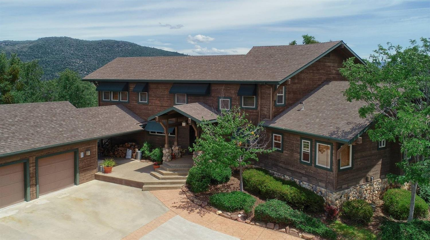 Take your breath away home! This custom Craftsman style home is stunning & located in the heart of Coarsegold w/original owner! Dramatic 2 story ceilings, slate flooring, beautiful view windows, rock fireplace in the living area. Dream kitchen w/island/breakfast bar, Wolf stove, Granite counters, built-in desk, 2nd sink, walk-in pantry & room for any chef to create! Enjoy the views from the sun room that converts to a screened-in porch. Media room is a great place for family movie night & a separate office. Great BDs w/a Jack 'n Jill BA & custom built details. Master retreat offers private deck access, fireplace & walk-in closet. Dbl. vanity, soaking tub & lots of storage in the master BA. Once outside, the striking view is everywhere! The deck is a great place to relax but continue to the in-ground pool, patio areas & beautiful outdoor kitchen! Swim surrounded by gorgeous mountain views! 3 car garage, 2 new AC units, good well, fenced basketball court, laundry chute & all on 40+/- AC!