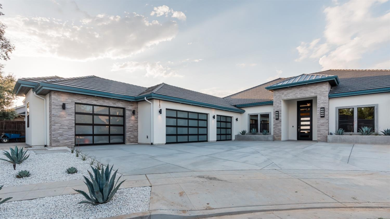 When you see this beautifully designed contemporary one of a kind home you will need to stop & remind yourself where you are. With 4BD, 3 1/2BA 3464 sq ft, w/ grand-views of the Sierra's & San Joaquin River, you will want to experience the sites from everywhere inside & out. Private terrace on the bluff w/ its personal fire pit. This home represents the best of indoor/outdoor bluff living. When you enter this private oasis you will be taken w/ the open floor plan, spaces for entertaining, gourmet chef's kitchen, walk-in pantry & topped off w/ rich quartz counter tops. The spacious family room boasts 42' of glass sliding doors opening to the backyards unbelievable views! The Lavish master suite w/ his/hers walk-in closets, stainless soaking tub & heated marble floors. 4 car garage on 20,000 sq ft lot is surrounded by drought tolerant landscape.This hidden gem is proudly built by Butler Construction.