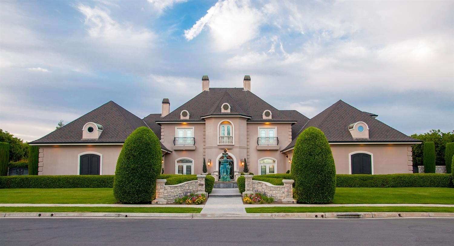 Premier Custom Home located within the privacy of La Vina Gated Community. Entry has Leaded Glass Doors, Stone Fireplace Surround ,Mantel Stone Columns . Sports Game Room features 23-Foot-High Ceilings all Cherry Wood Walls w/ eight Built-In Display Cases, Cherry Wood Fireplace w/ Granite Surround, Leaded Glass French Doors also includes a Powder Room. Formal Dining Room, Custom Built Kitchen w/ Breakfast Nook, Theater Room w/ 8 Theater Chairs TV, Bar/Card Room, Library, Den, Exercise Room, Laundry Room, Master Bedroom/ Bath, Travertine Tile Flooring throughout entire house, Cherry Wood Cabinets & 6 Fireplaces. The front features a Gorgeous Fountain, Artificial Turf, Patio includes BBQ W/features, Fireplace /T.V., Surround Sound, Stamped Concrete, Custom Salt Water Pool, Outside Bathroom ,Gorgeous English Garden.  2 separate Garages w/Tile Flooring , large wall of Storage Cabinets, Exercise room upstairs Garage fully carpeted, Storage. See attached list for all amenities .
