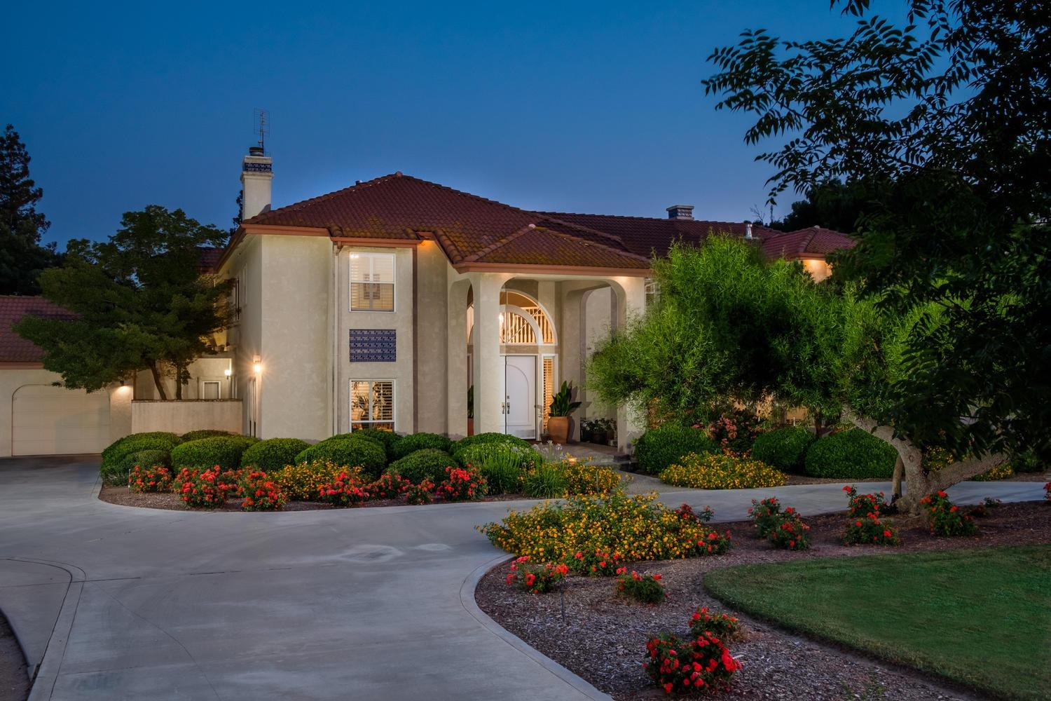 This luxurious 6 bedroom, 5 1/2 bath property is surrounded by picture perfect landscaping, a pool, and tennis courts, which you can enjoy from the second-story master balcony. This home has a sunken living room, and office and two bedrooms on the first floor, with one being an isolated bedroom and bathroom; perfect mother-in-law or guests quarters. A large family room with a separate bar, wine cellar, and lounge area. The spacious kitchen and breakfast nook are bright and full of light with views of the gorgeous park-like backyard.  The wide cascading staircase leads to 3 additional bedrooms and the master suite.  The master has 2 walk-in closets, a large bathroom, jetted tub, and full patio balcony. This is an impressive property offers both luxury and privacy!